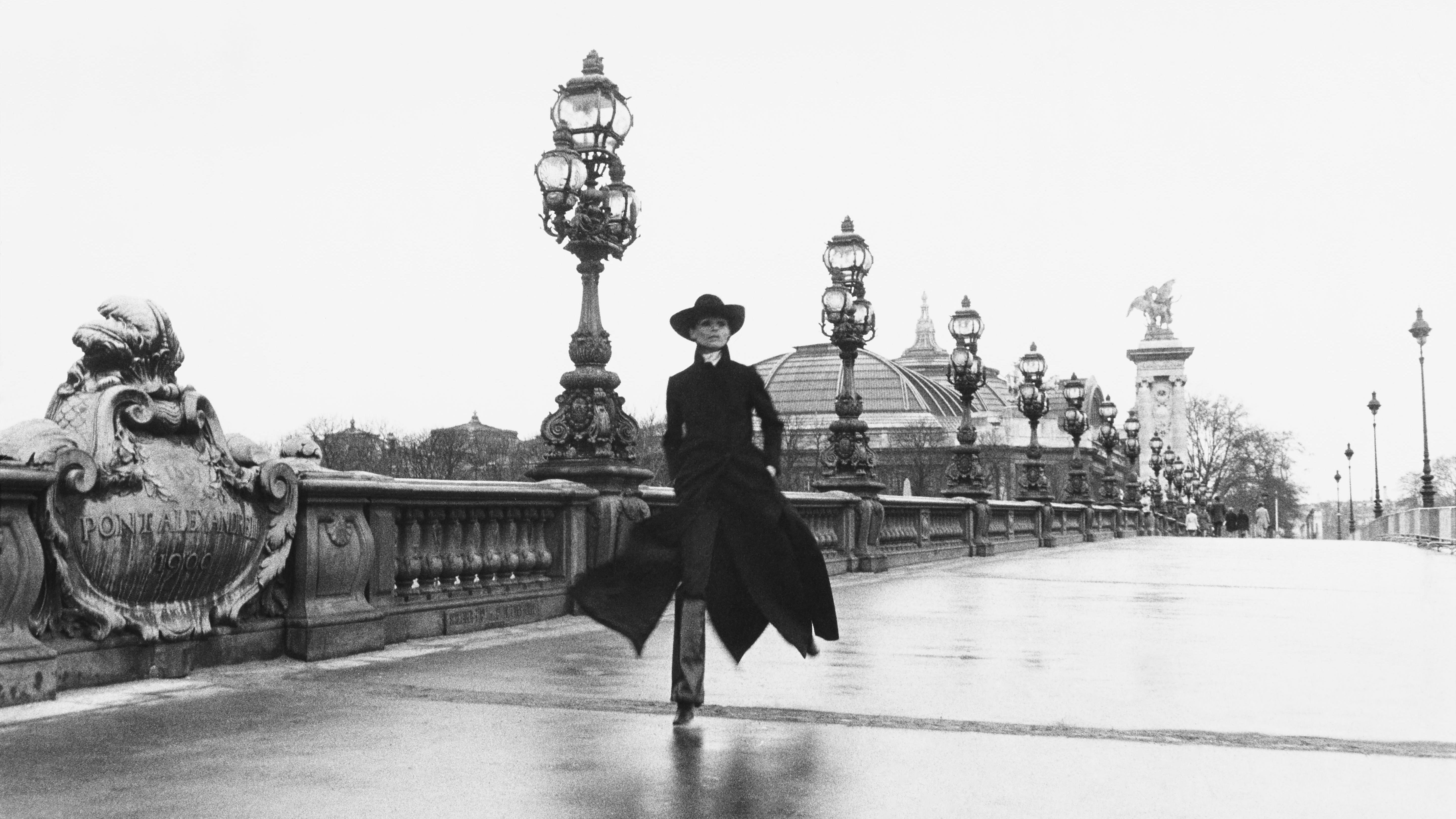 Model Chantal Dumont crosses the Alexandre III bridge in Paris.