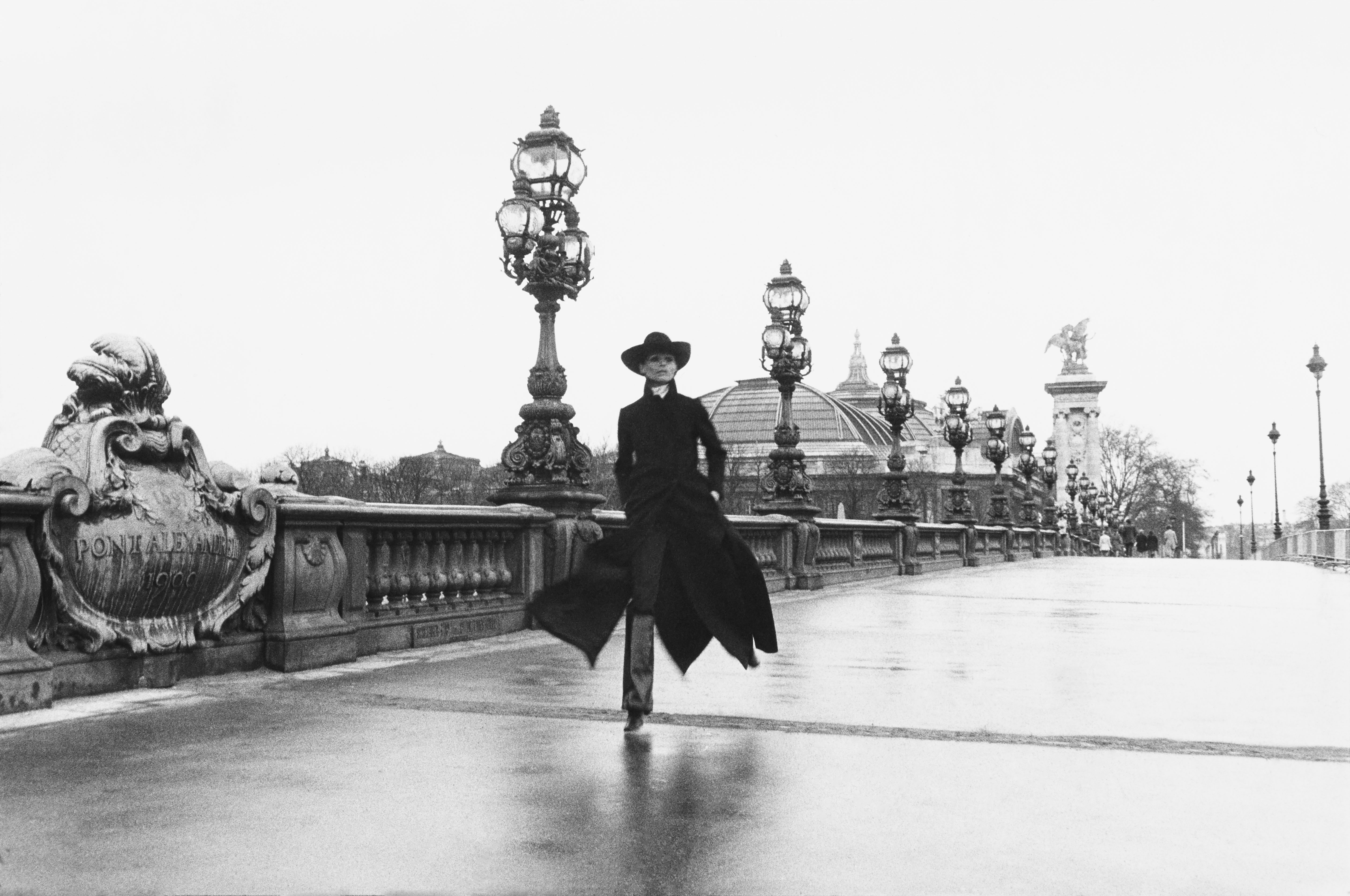 Model Chantal Dumont crosses the Alexandre III bridge in Paris.