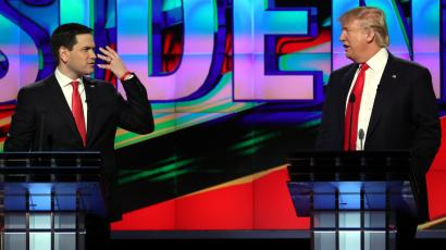 Republican U.S. presidential candidates Donald Trump (R) and Marco Rubio talk at each other during a debate sponsored by CNN at the University of Miami in Miami, Florida, March 10, 2016.