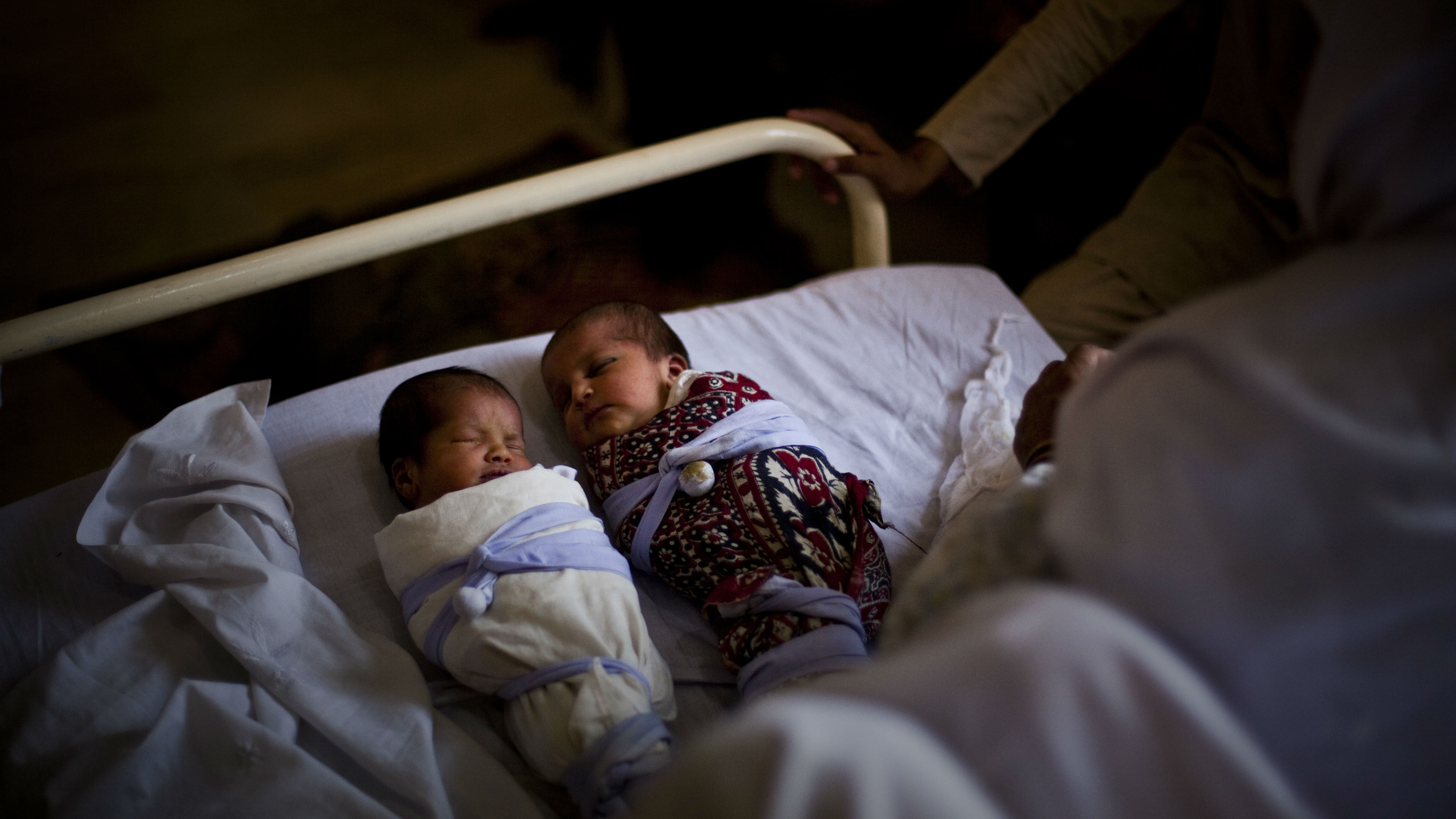 In this photo taken on May 26, 2009, new born twins babies from internally displaced family from Swat valley, sleep at the Mardan Medical Complex in Mardan, Pakistan. Overwhelmed by more than two million people, who have escaped from the mountainous northwest where the army is battling Taliban insurgents, Pakistan's rundown health care system is near collapse, say health officials.