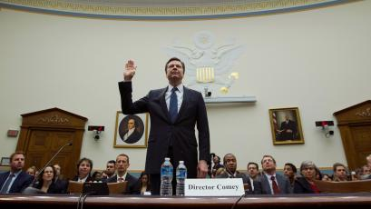 FBI Director James Comey is sworn in on Capitol Hill in Washington, Tuesday, March 1, 2016, prior to testifying before the House Judiciary Committee hearing on 'The Encryption Tightrope: Balancing Americans' Security and Privacy.' ( AP Photo/Jose Luis Magana)