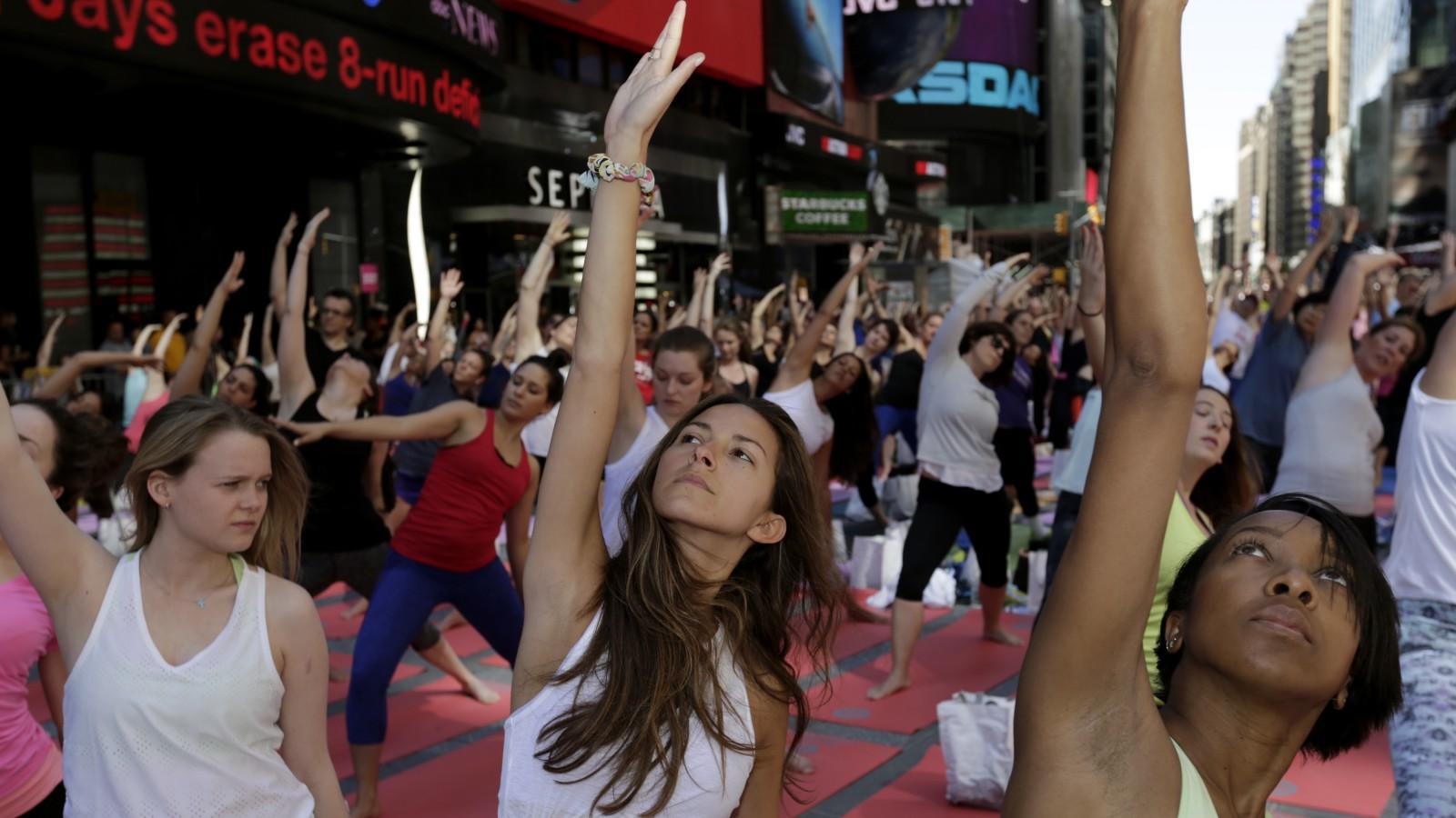 Women practice power yoga.