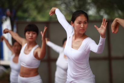 People do yoga during a gathering event of yoga show on July 5, 2015 in Hanzhong, Shaanxi Province of China. Nearly 300 people do yoga together to encourage more people to join yoga exercise.
