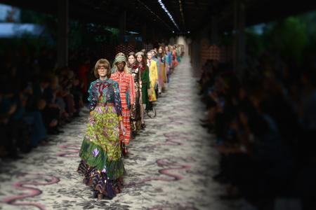 PICTURE TAKEN WITH A TILT AND SHIFT LENS - Models present creations for fashion house Gucci during the women Spring / Summer 2016 Milan's Fashion Week on September 23, 2015 in Milan. AFP PHOTO / TIZIANA FABI (Photo credit should read TIZIANA FABI/AFP/Getty Images)