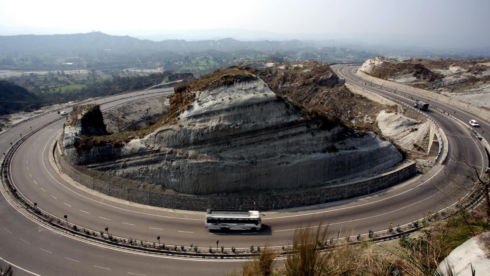Vehicles Pass Through Jammu Srinagar National Highway At Ban About 25 Km From