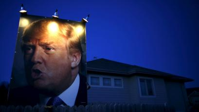 A picture of Trump hangs outside a house in West Des Moines, Iowa.