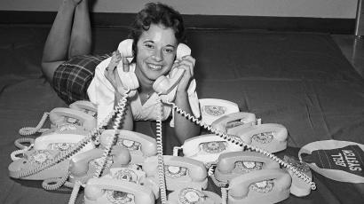 Long distance operator Elizabeth Keener, 18, poses with the Princess, an oval-shaped telephone called an attempt to obtain a design of classic simplicity by designer Henry Drefuss of Bell Laboratories, Sept. 3, 1959, Atlanta, Ga. Bell says it is the sixth major home telephone alteration since the original invention in 1876. (AP Photo/Horace Cort)