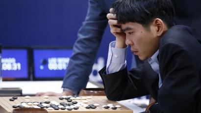 South Korean professional Go player Lee Sedol reviews the match after finishing the third match of the Google DeepMind Challenge Match against Google's artificial intelligence program, AlphaGo, in Seoul, South Korea, Saturday, March 12, 2016.