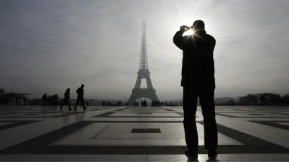 man and eiffel tower