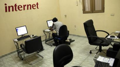 An Internet user surfs the net at a branch of the state-run telecommunications company, ETECSA, in Havana