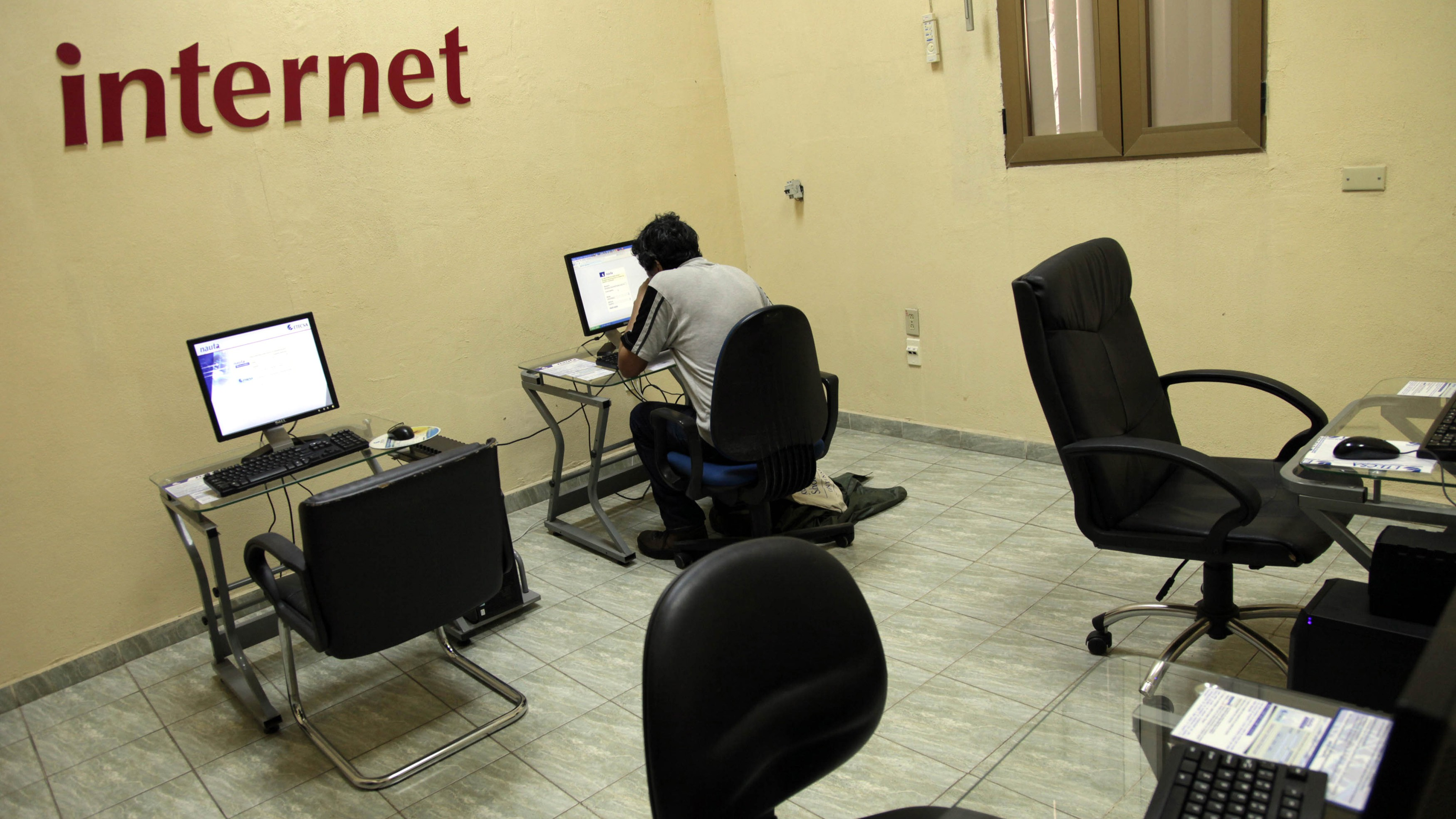 """An Internet user surfs the net at a branch of the state-run telecommunications company, ETECSA, in Havana June 4, 2013. Cuba began offering broader Internet access through 118 outlets around the country, according to a decree in the government's Official Gazette, in a step long awaited by many Cubans. The decree made clear that the new Internet access would be closely monitored, warning users it could not be used to """"endanger or prejudice public security, or the integrity and sovereignty of the nation."""""""