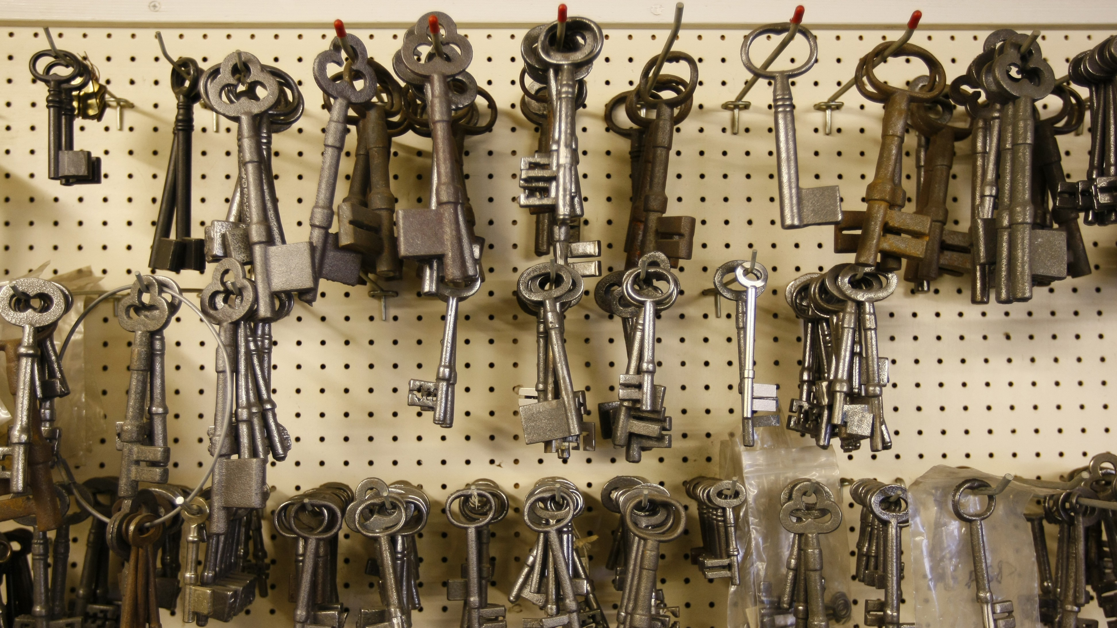 Key blanks hang on pegs at a lock and key shop in Lichfield