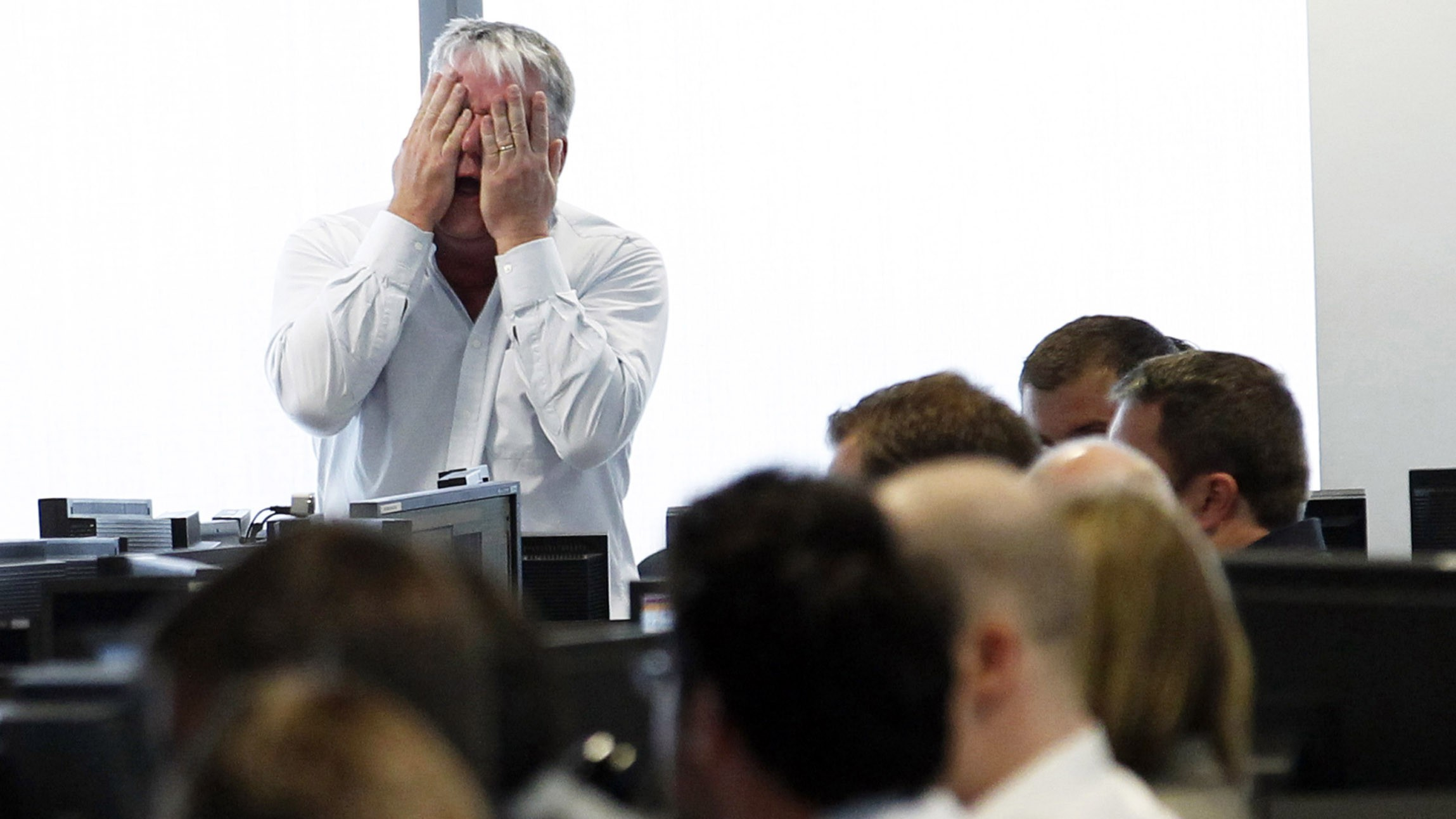 A broker reacts at BGC Partners at Canary Wharf financial district in London