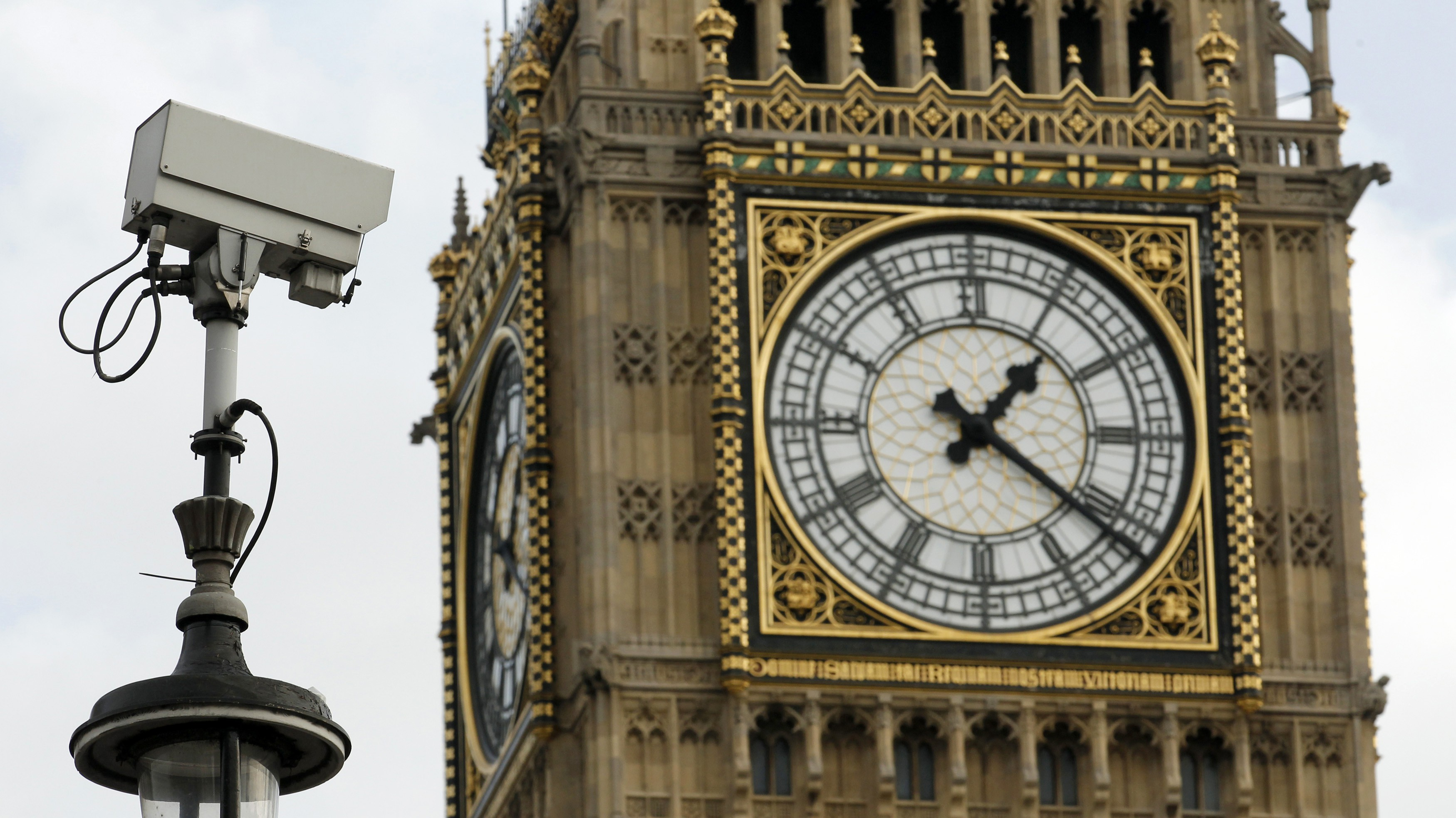 A surveillance camera points towards Parliament Square, in front of the Big Ben Clock Tower in London October 18, 2010. Terrorism and cyber attacks will be identified on Monday as the main threats to Britain in a new security strategy, a plan likely to be used to justify cuts to major hardware orders in a sweeping military review a day later. REUTERS/Luke MacGregor  (BRITAINPOLITICS MILITARY - Tags: MILITARY POLITICS CRIME LAW) - RTXTK55