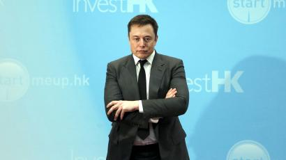 Tesla Chief Executive Elon Musk stands on the podium as he attends a forum on startups in Hong Kong, China January 26, 2016.