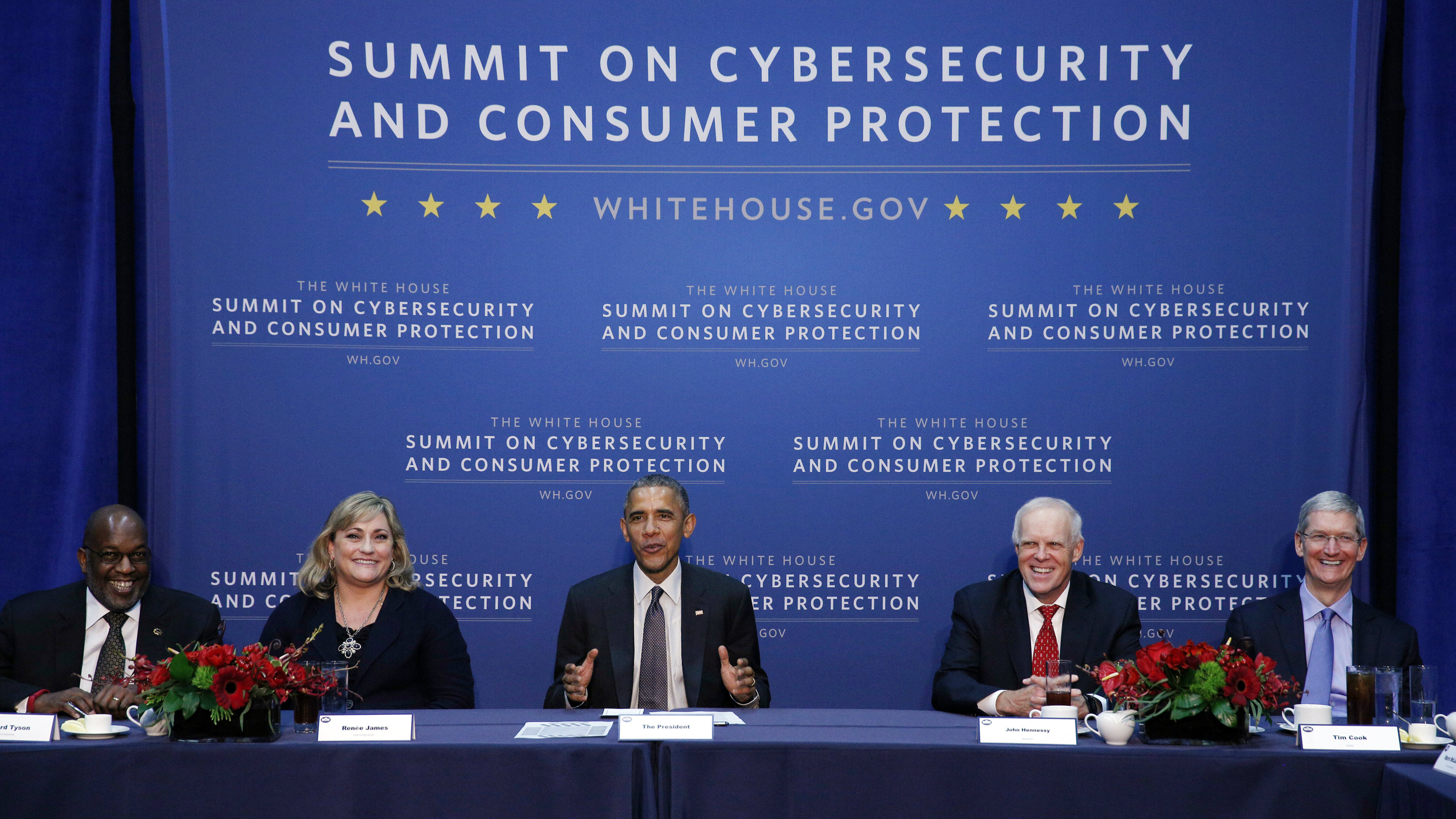 U.S. President Barack Obama holds a round table with business leaders at the Summit on Cybersecurity and Consumer Protection at Stanford University in Palo Alta, California February 13, 2015. From left are Bernard Tyson of Kaiser Permanente, Renee James of Intel, Obama, Stanford University President John Hennessy and Apple CEO Tim Cook. The aim of the summit is to build support for beefing up cyber security laws in the wake of massive hacked at Target, Sony and Anthem. REUTERS/Kevin Lamarque (UNITED STATES - Tags: POLITICS BUSINESS SCIENCE TECHNOLOGY)