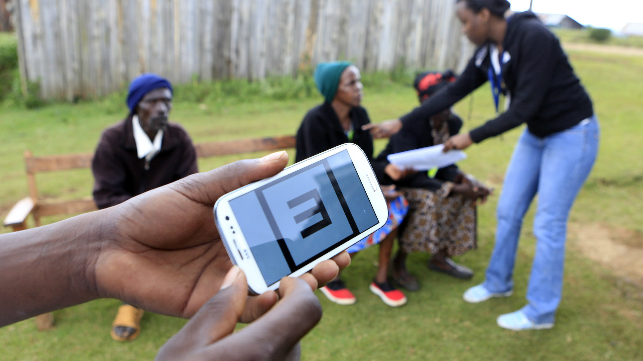 Eye patients wait in the background as a Smartphone apparatus is seen for eye examinations at a temporary clinic by International Centre for Eye Health at Olenguruone in the Mau Summit 350km (217 miles) west of Kenya's capital Nairobi, October 29, 2013.