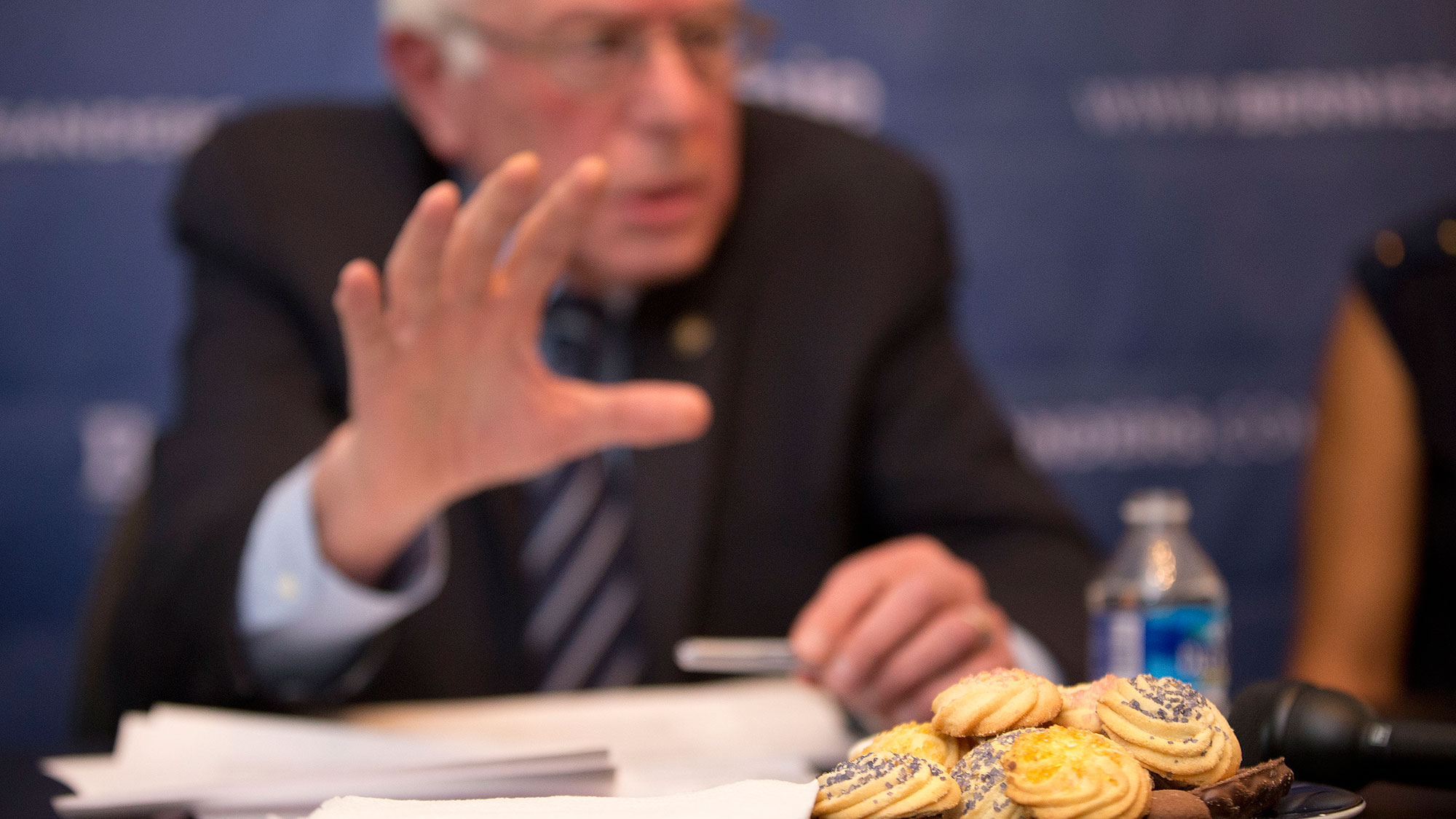 A plate of cookies are seen on the table infront of Democratic presidential candidate, Sen. Bernie Sanders, I-Vt., as he discusses his immigration plan, during a live broadcast from his campaign office in Washington, Monday, Dec. 7, 2015. (AP Photo/Pablo Martinez Monsivais)