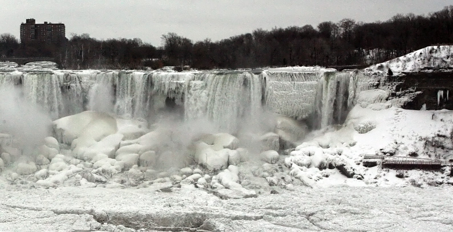 """In this Jan. 10, 2014 photo, the United States side of Niagara Falls in New York has begun to thaw after the recent """"polar vortex"""" that affected millions in the United Sates and Canada."""