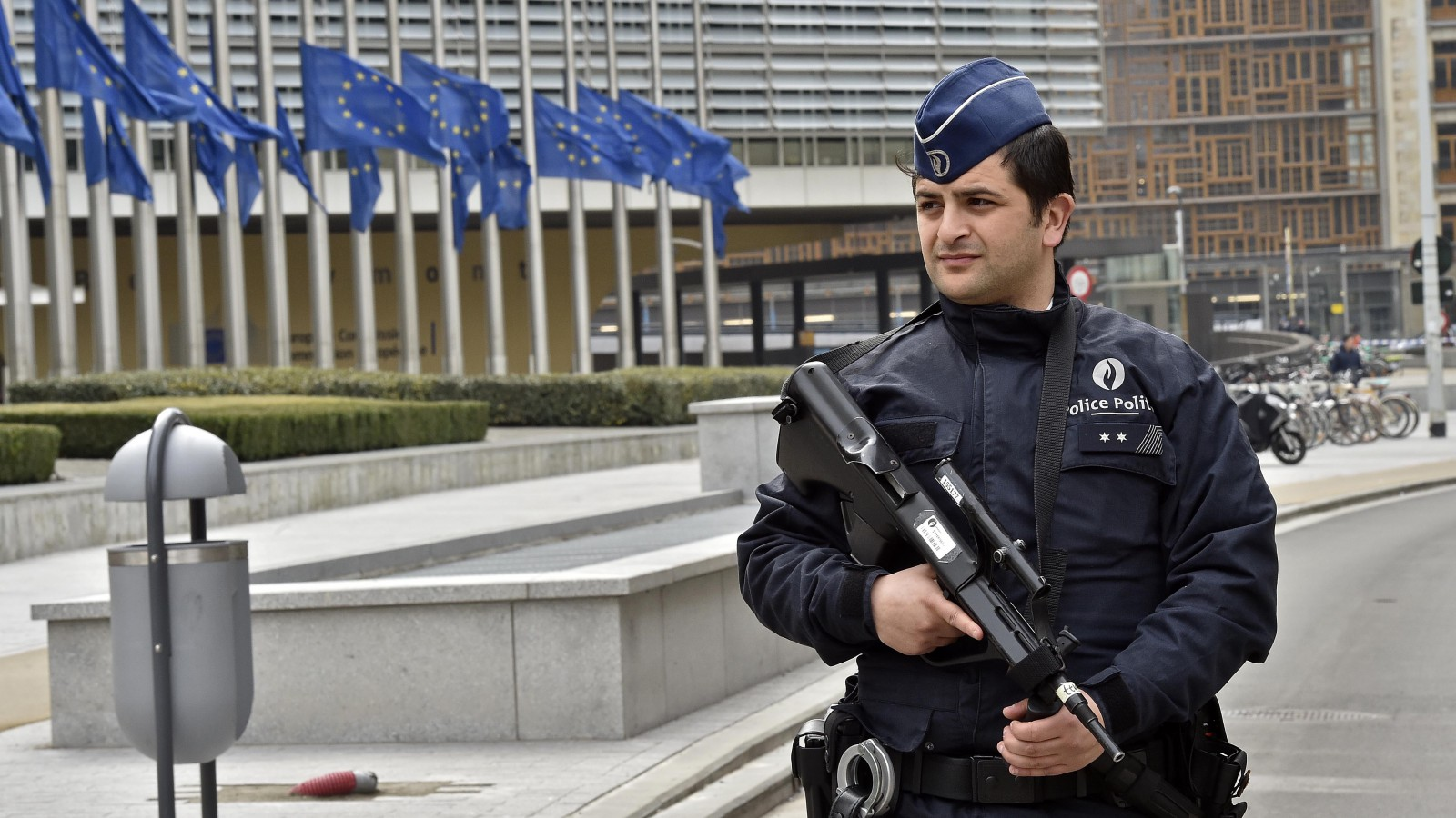 Police patrol the EU commission building.