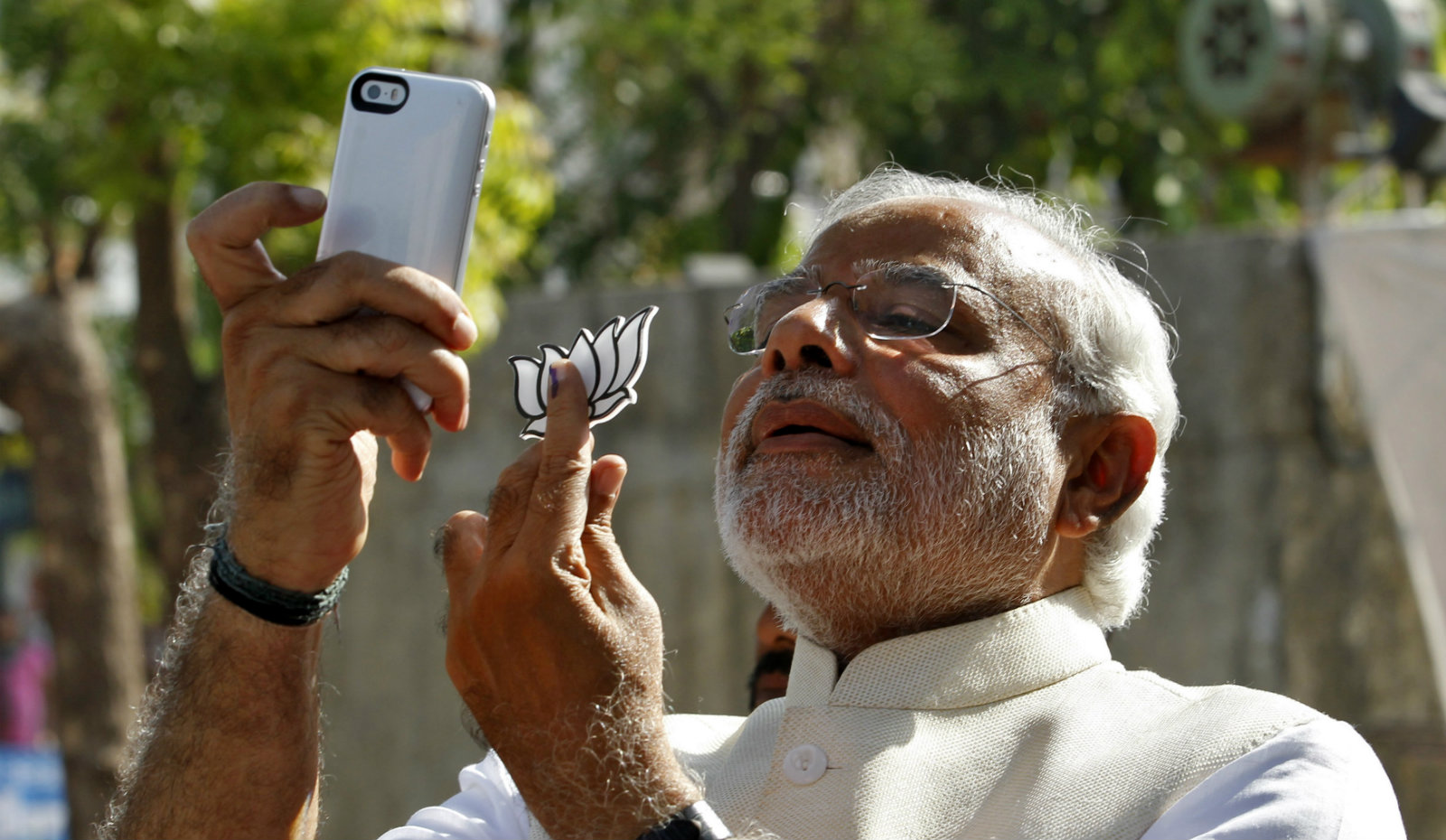 """Hindu nationalist Narendra Modi, the prime ministerial candidate for India's main opposition Bharatiya Janata Party (BJP), takes a """"selfie"""" with a mobile phone after casting his vote at a polling station during the seventh phase of India's general election in the western Indian city of Ahmedabad April 30, 2014. Around 815 million people have registered to vote in the world's biggest election - a number exceeding the population of Europe and a world record - and results of the mammoth exercise, which concludes on May 12, are due on May 16."""