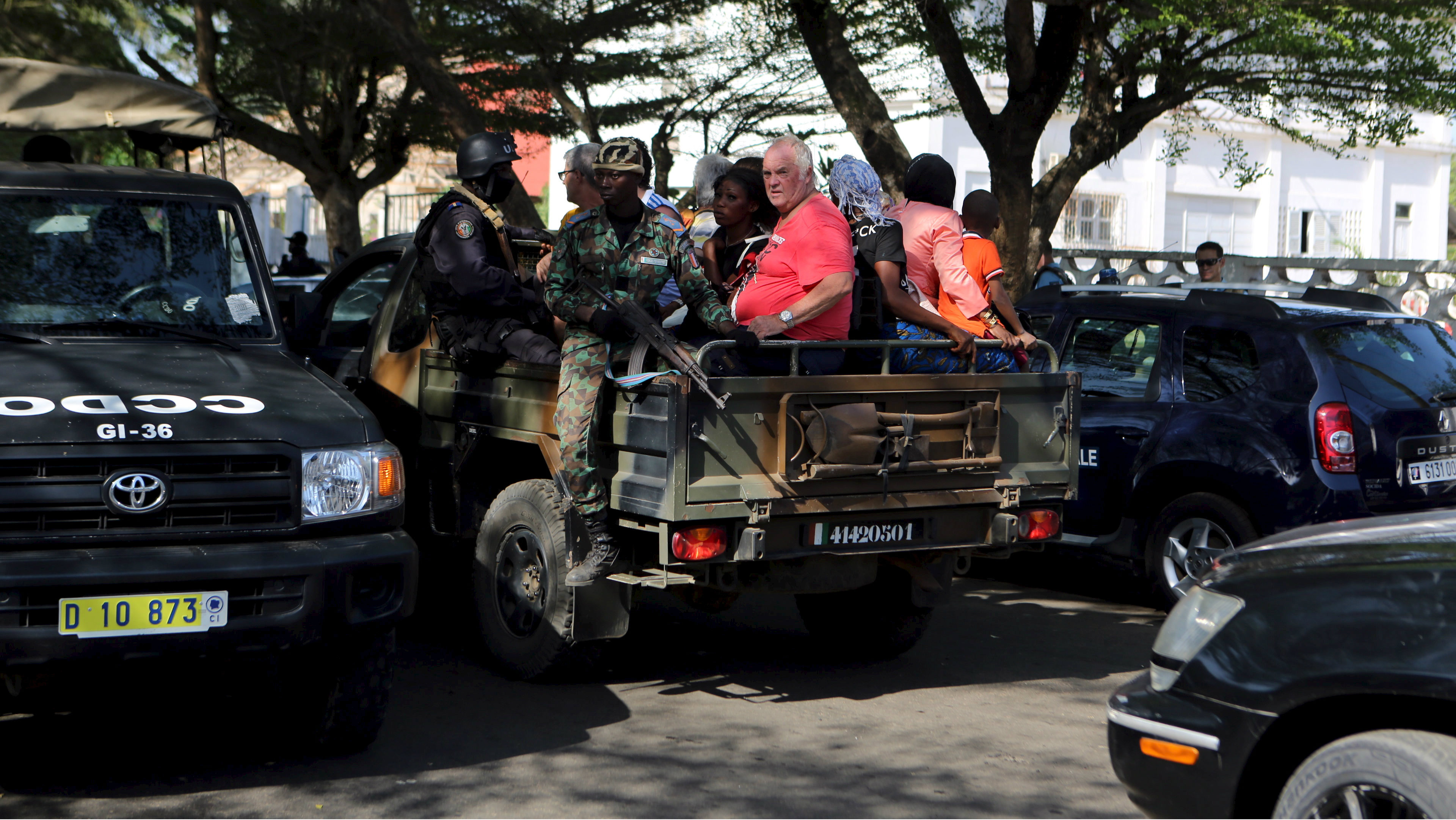 Security forces evacuate people in Bassam, Ivory Coast, March 13, 2016