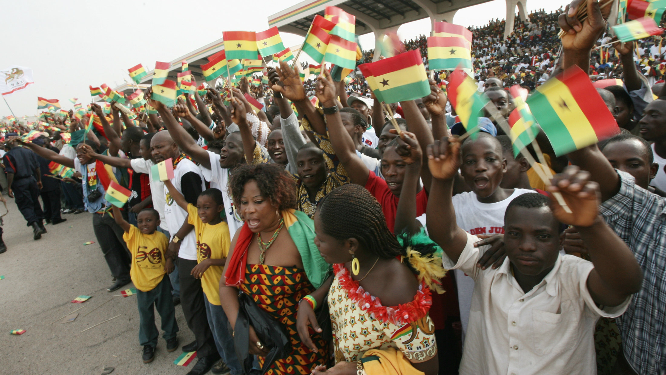 People raise national flags at Independence Square during celebrations marking the 50th anniversary of the country's independence in Accra March 6, 2007