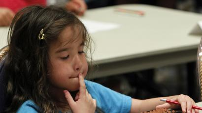 An elementary schoolgirl takes part in an abacus contest in Tokyo