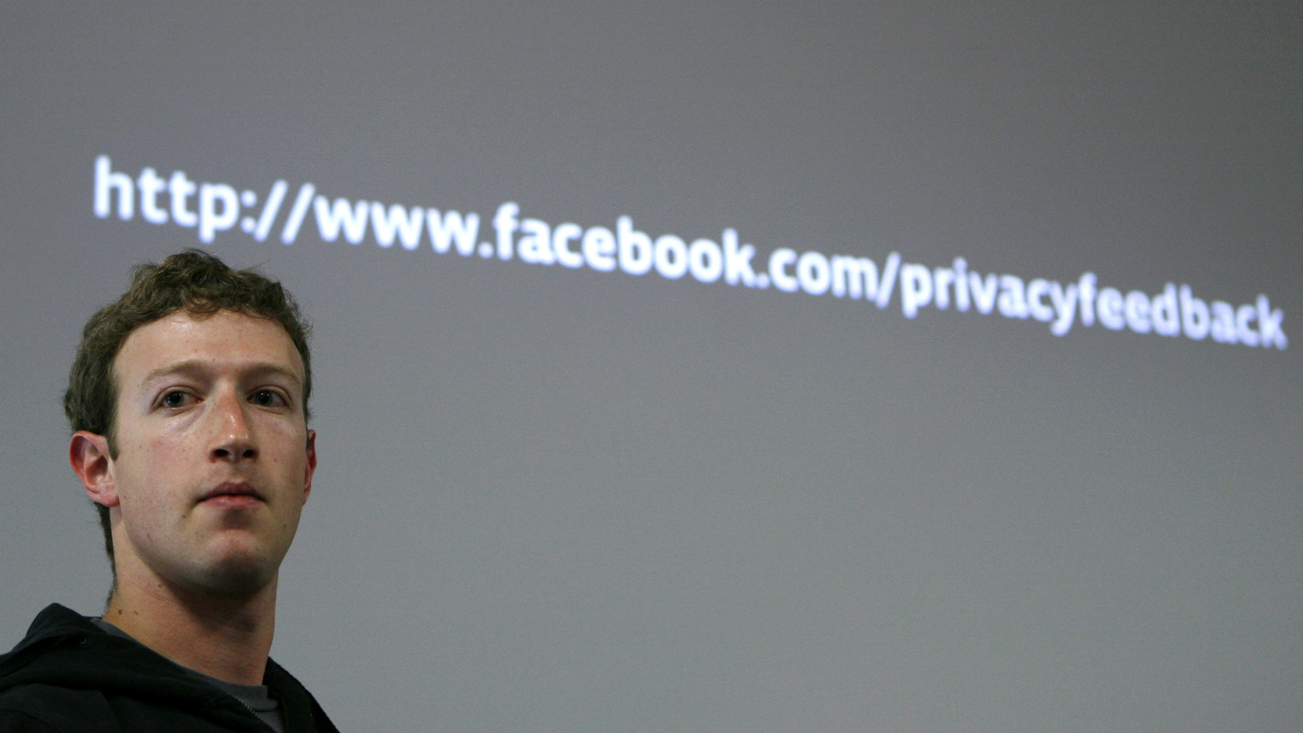 Facebook CEO Mark Zuckerberg takes a question during a news conference.