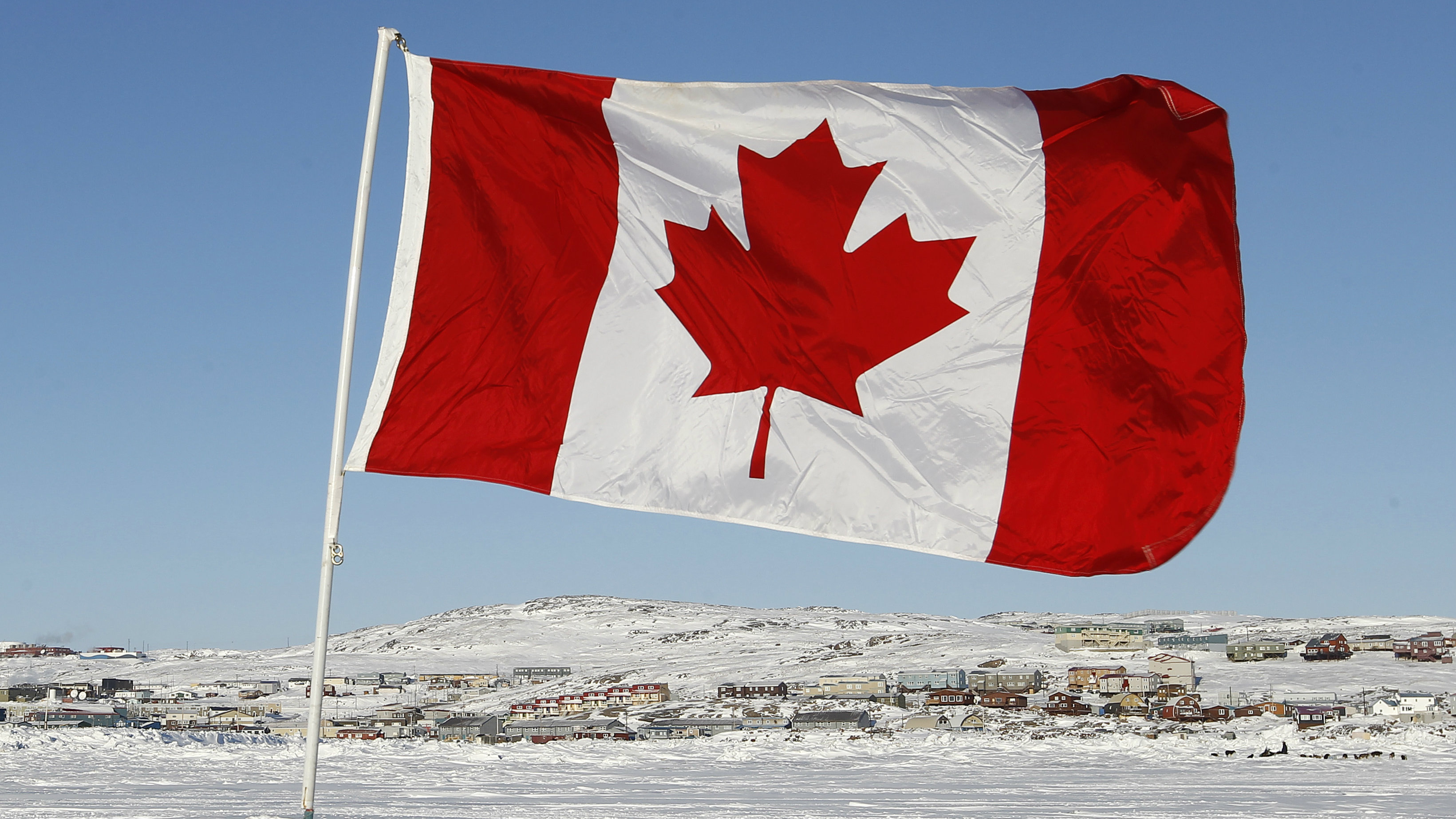 A Canadian flag is pictured on Frobisher Bay in Iqaluit, Nunavut February 23, 2012.