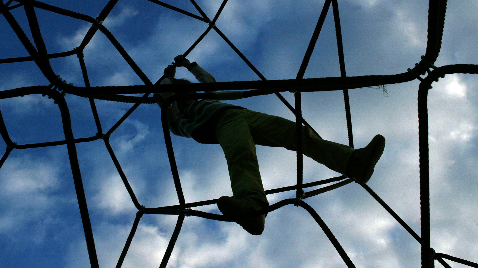 A child plays on a rope-climbing frame in northern Spain.