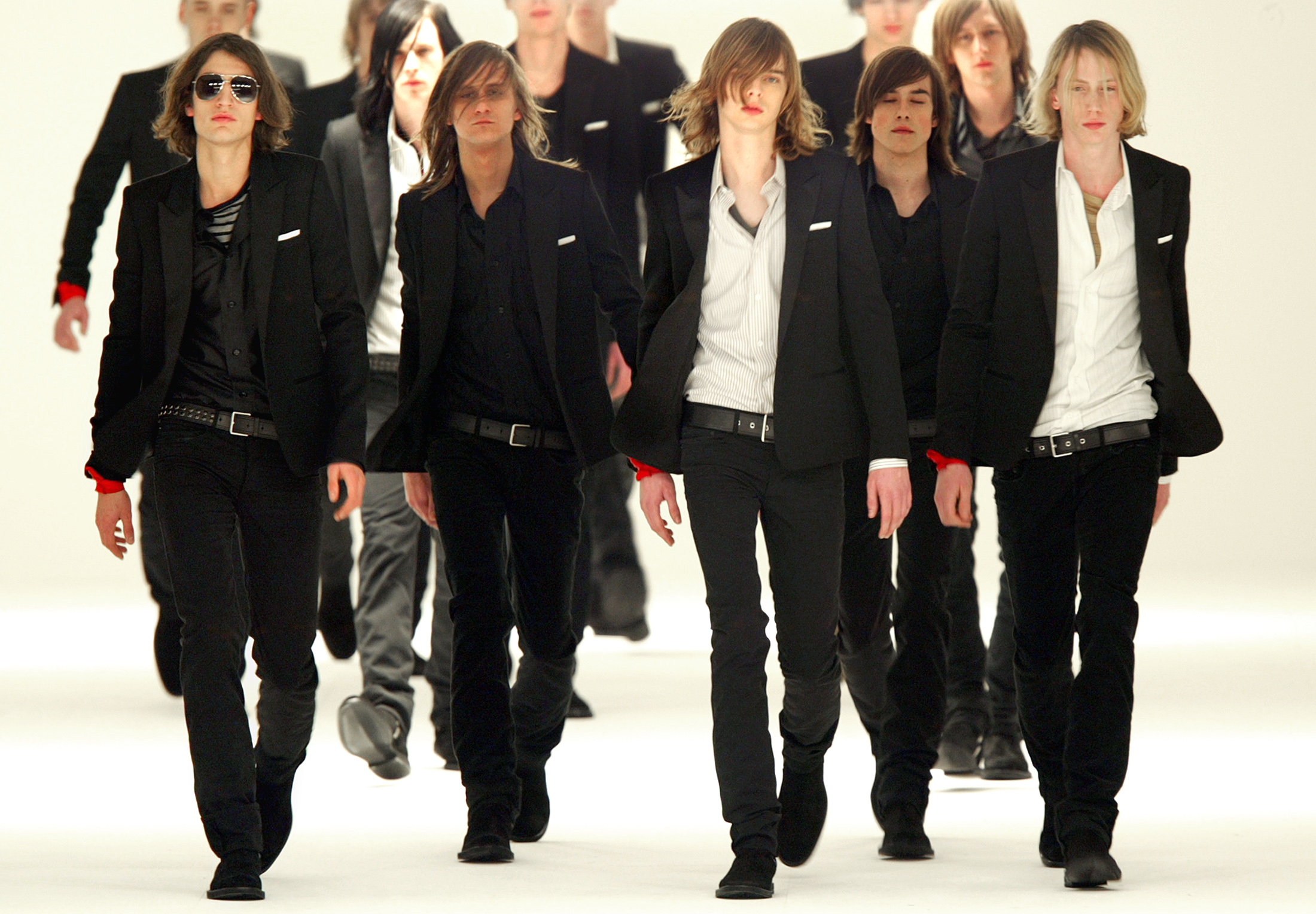 Models display creations by French designer Hedi Slimane as part of the Dior fall winter 2004/2005 men's collection at Paris fashion week, January 26, 2004.