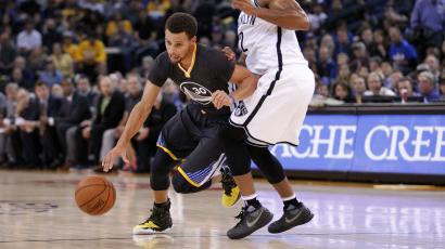 Nov 14, 2015; Oakland, CA, USA; Golden State Warriors guard Stephen Curry (30) dribbles past Brooklyn Nets guard Jarrett Jack (2) in the first quarter at Oracle Arena.