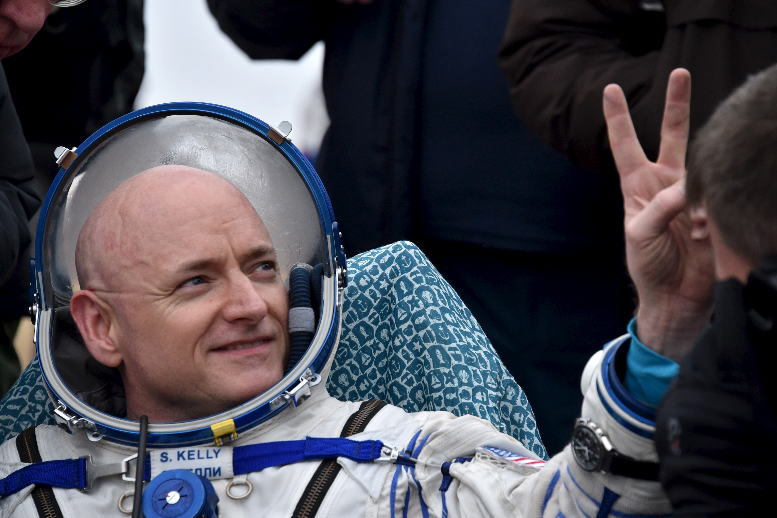U.S. astronaut Scott Kelly gestures shortly after landing near the town of Dzhezkazgan