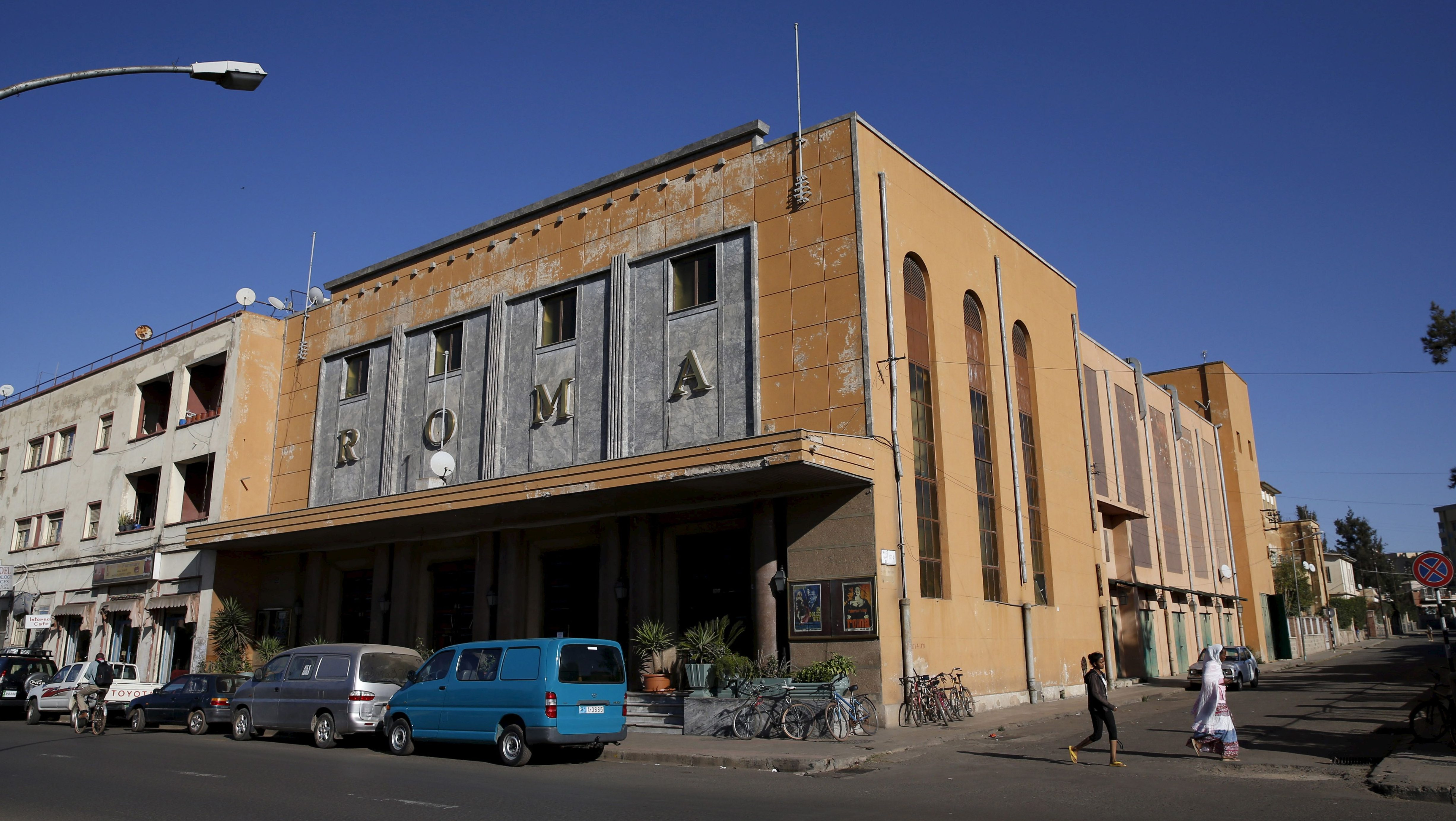 """A general view shows the Roma Cinema on Samatat Avenue in Eritrea's capital Asmara, February 20, 2016. Eritrea's capital city boasts one of the world's finest collections of early 20th century architecture, which the authorities want declared a UNESCO World Heritage Site. When Italy's colonial experiment in Eritrea ended in 1941, it left behind an array of Rationalist, Futurist, Art Deco and other styles of Modernism in Asmara, a city they nicknamed """"La Piccola Roma"""" or """"Little Rome""""."""