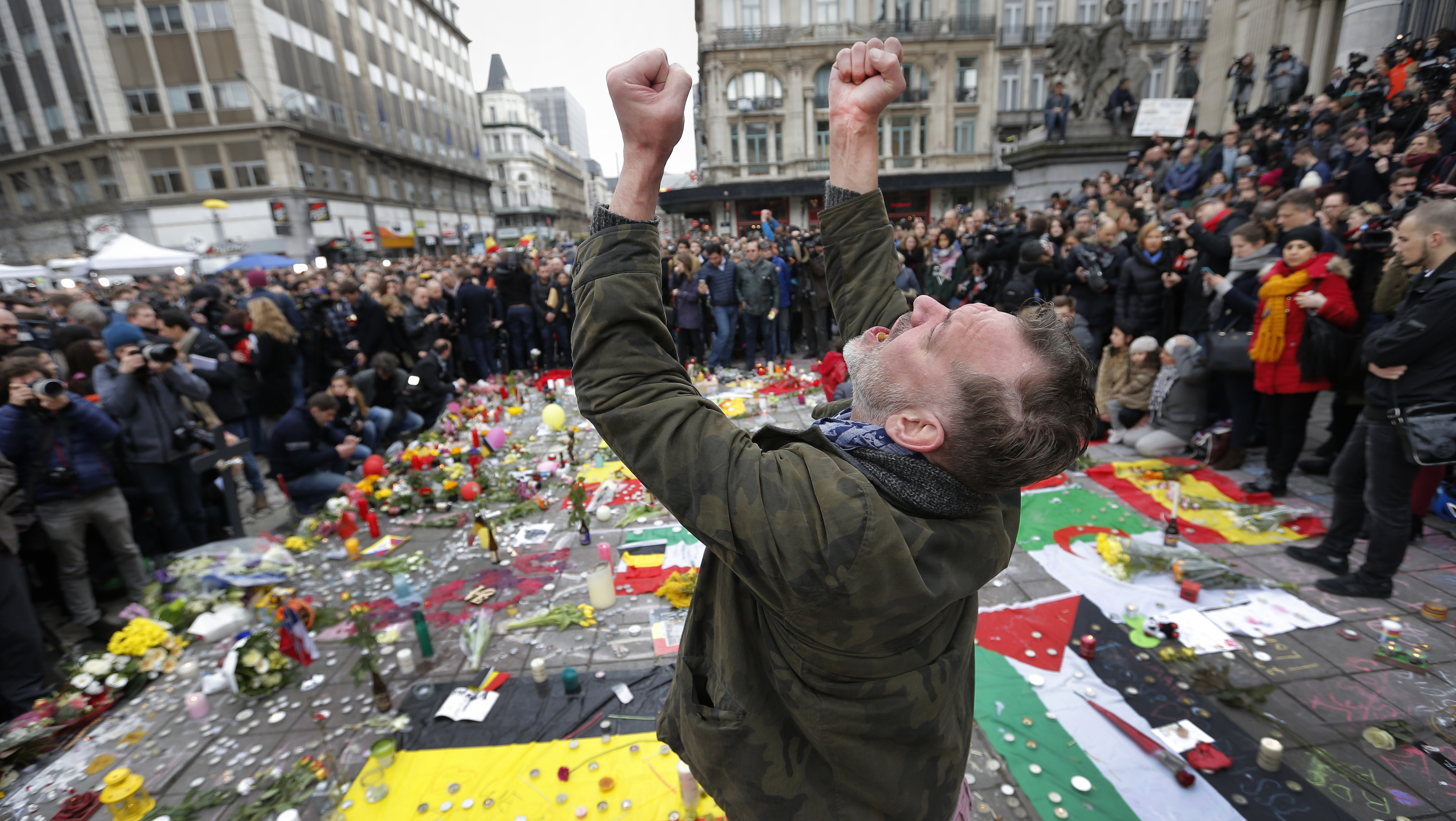 A man reacts at a street memorial following bomb attacks in Brussels, Belgium
