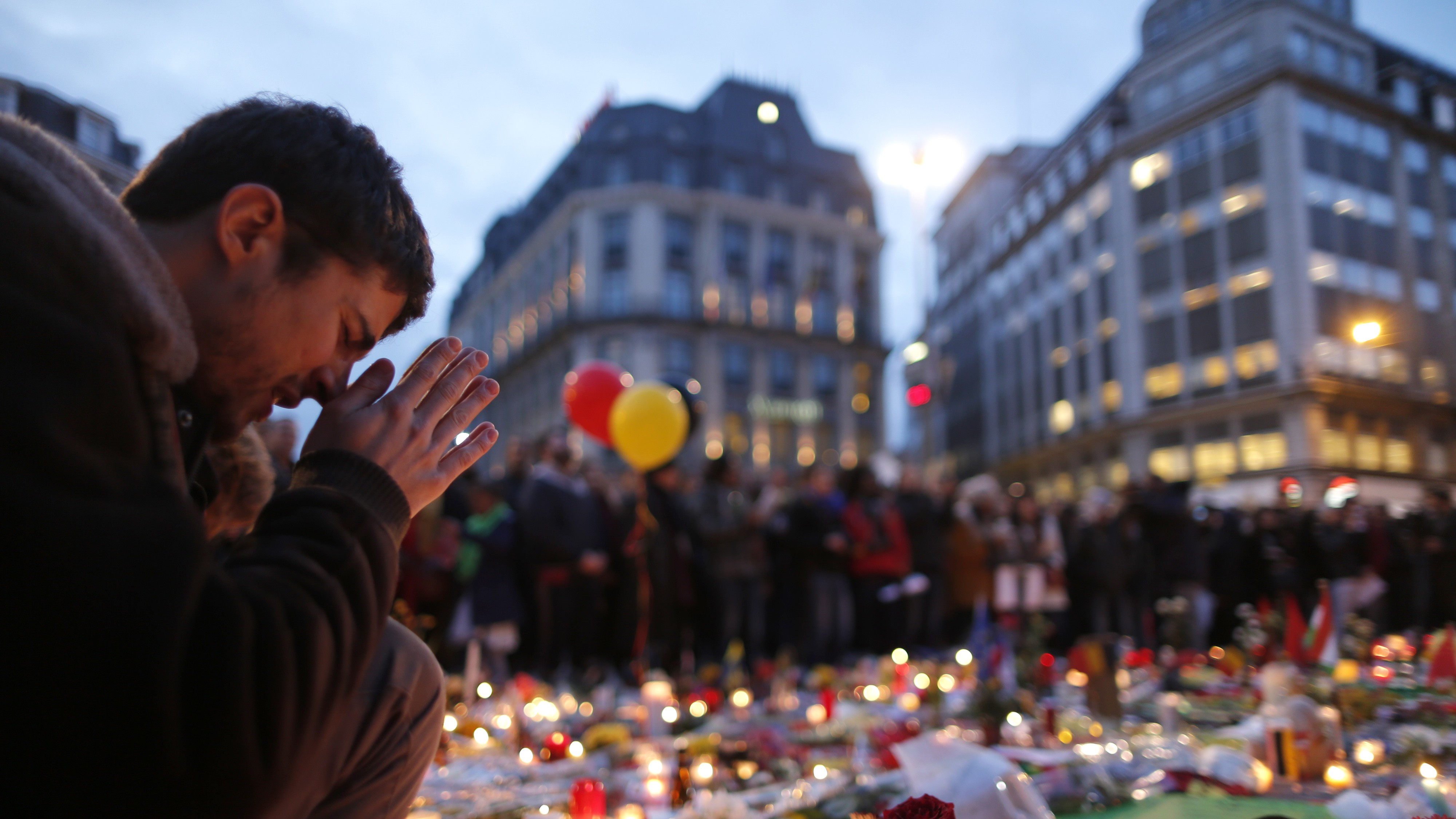 A man attends a memorial gathering near the old stock exchange in Brussels following bomb attacks in Brussels, Belgium