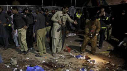 Security officials gather at the site of a blast outside a public park in Lahore, Pakistan, March 27, 2016.