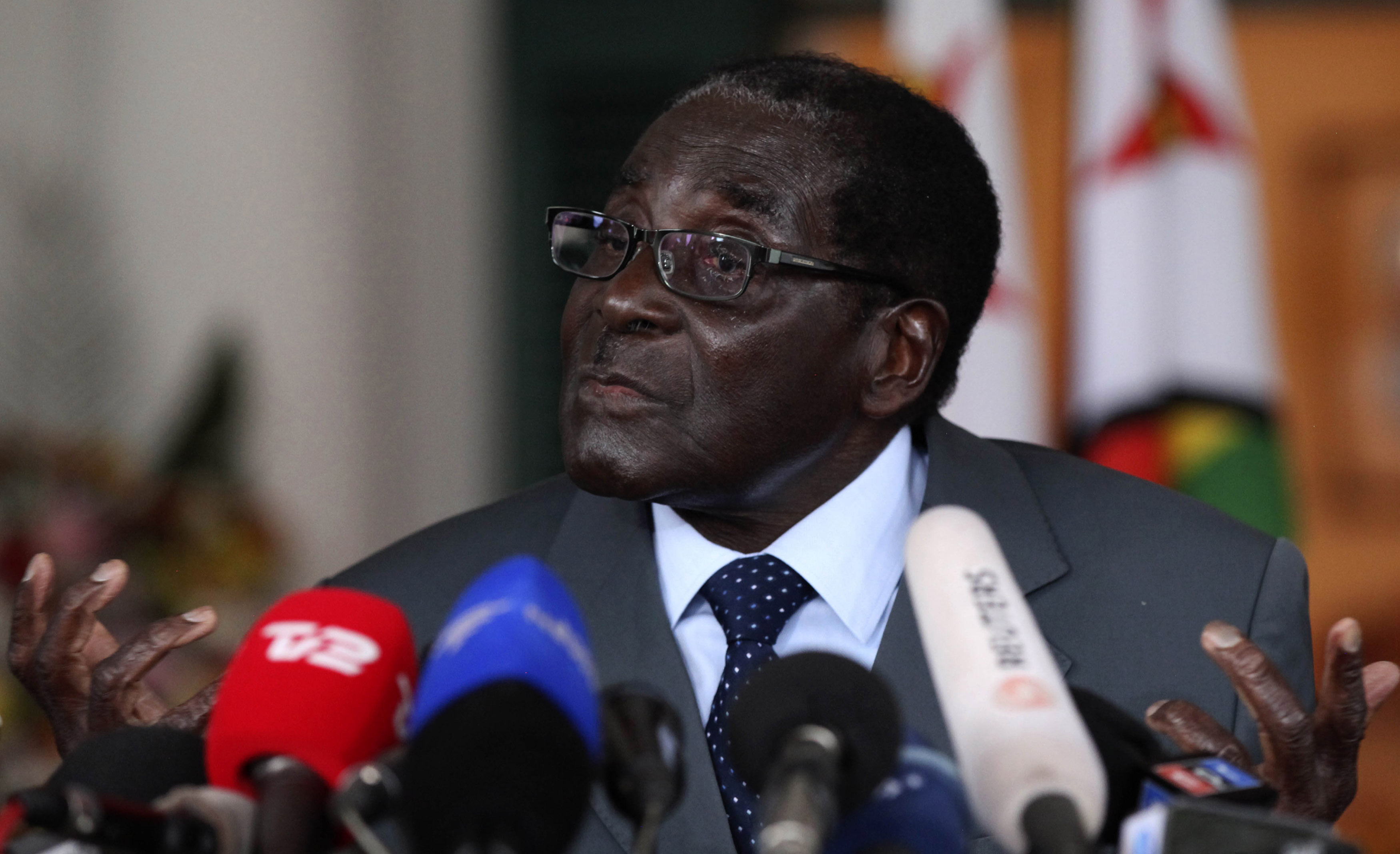 Zimbabwe's President Robert Mugabe addresses a media conference at State house in Harare, on the eve of the country's general elections, July 30, 2013. Heavily armed riot police deployed in potential election flashpoints in Zimbabwe on Tuesday on the eve of a poll showdown between Mugabe and Prime Minister Morgan Tsvangirai that remains too close to call.