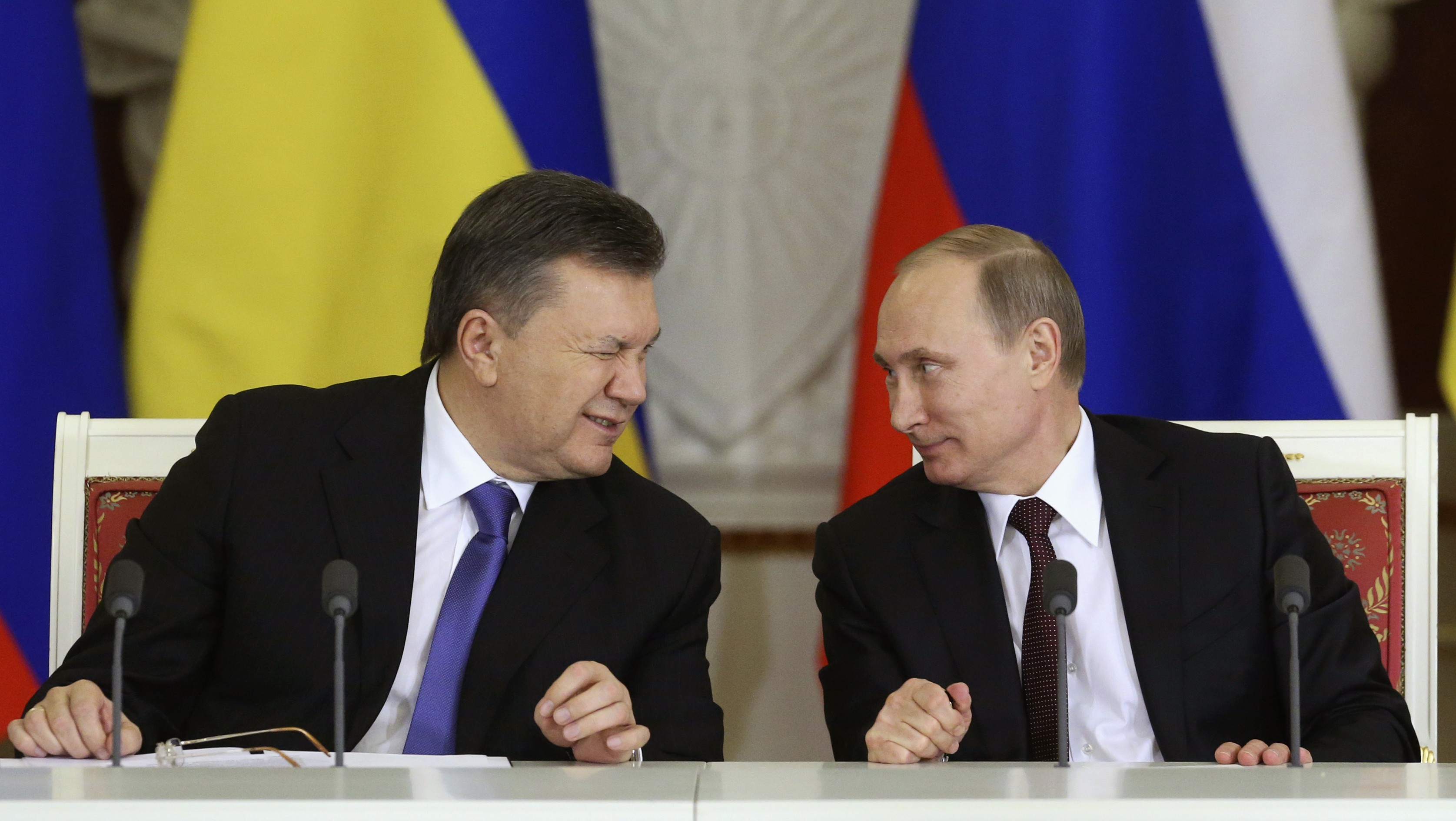 Ukrainian President Yanukovich gives a wink to his Russian counterpart Putin during a signing ceremony after a meeting of the Russian-Ukrainian Interstate Commission at the Kremlin in Moscow