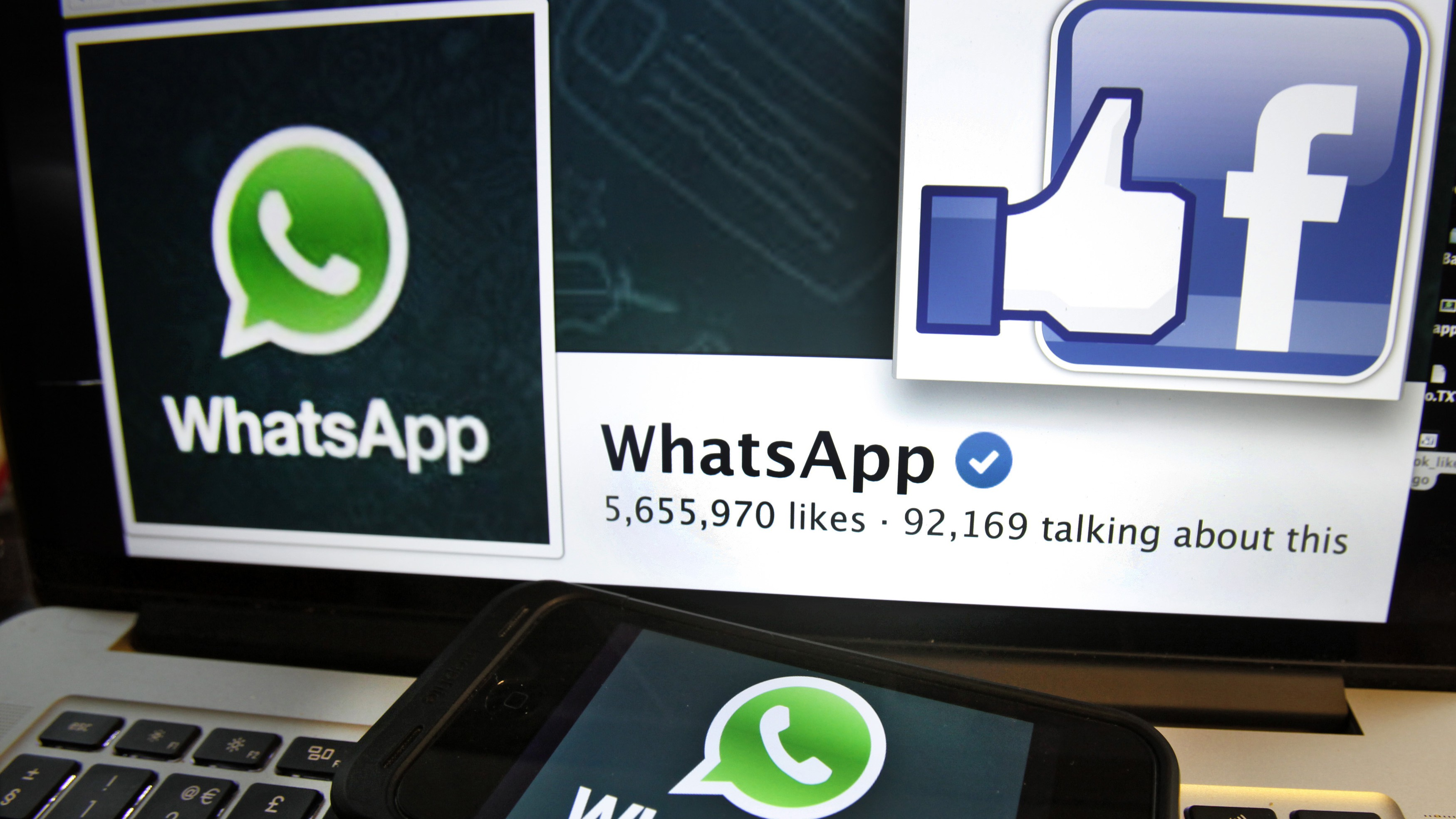 """Illustration photo shows """"likes"""" on WhatsApp's Facebook page displayed on a laptop screen in Paris February 20, 2014. Facebook Inc will buy fast-growing mobile-messaging startup WhatsApp for $19 billion in cash and stock in a landmark deal that places the world's largest social network closer to the heart of mobile communications and may bring younger users into the fold. REUTERS/Mal Langsdon (FRANCE - Tags: SCIENCE TECHNOLOGY BUSINESS TELECOMS) - RTX195S3"""