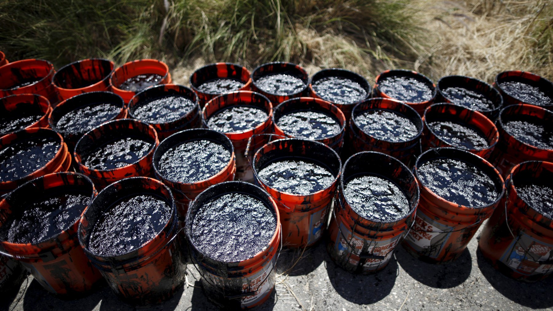Buckets of oil volunteers carried from an oil slick along the coast of Refugio State Beach are seen in Goleta, California.