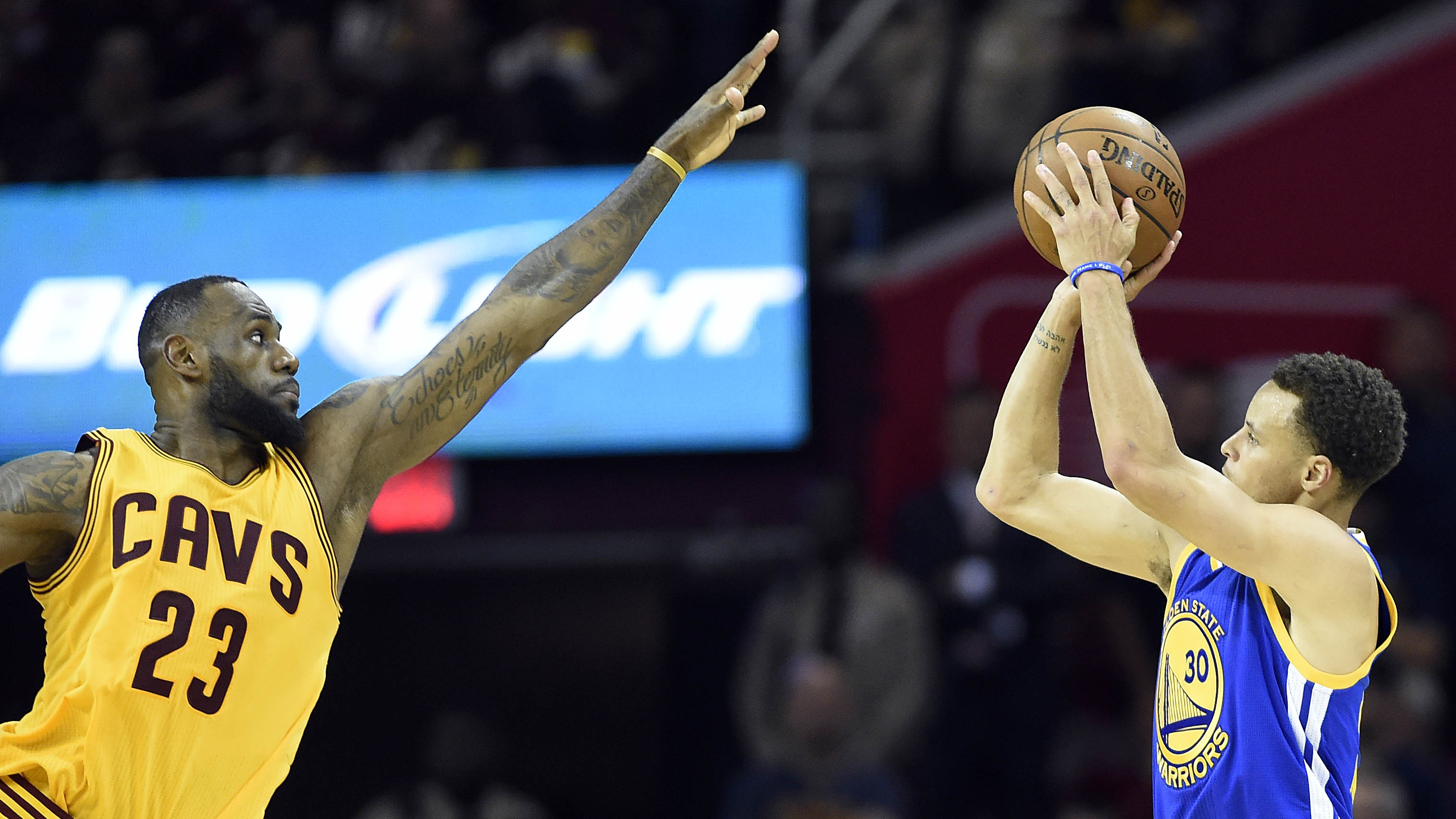 Jun 9, 2015; Cleveland, OH, USA; Golden State Warriors guard Stephen Curry (30) shoots the ball over Cleveland Cavaliers forward LeBron James (23) during the fourth quarter in game three of the NBA Finals at Quicken Loans Arena.