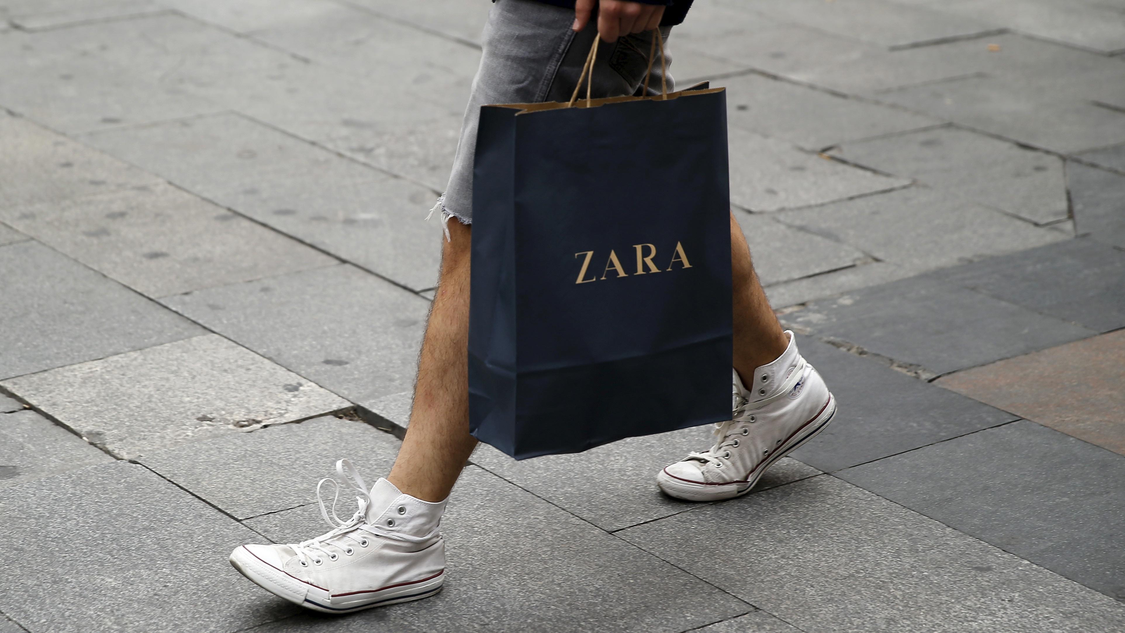 A man walks with a Zara bag in Madrid, Spain, June 10, 2015.