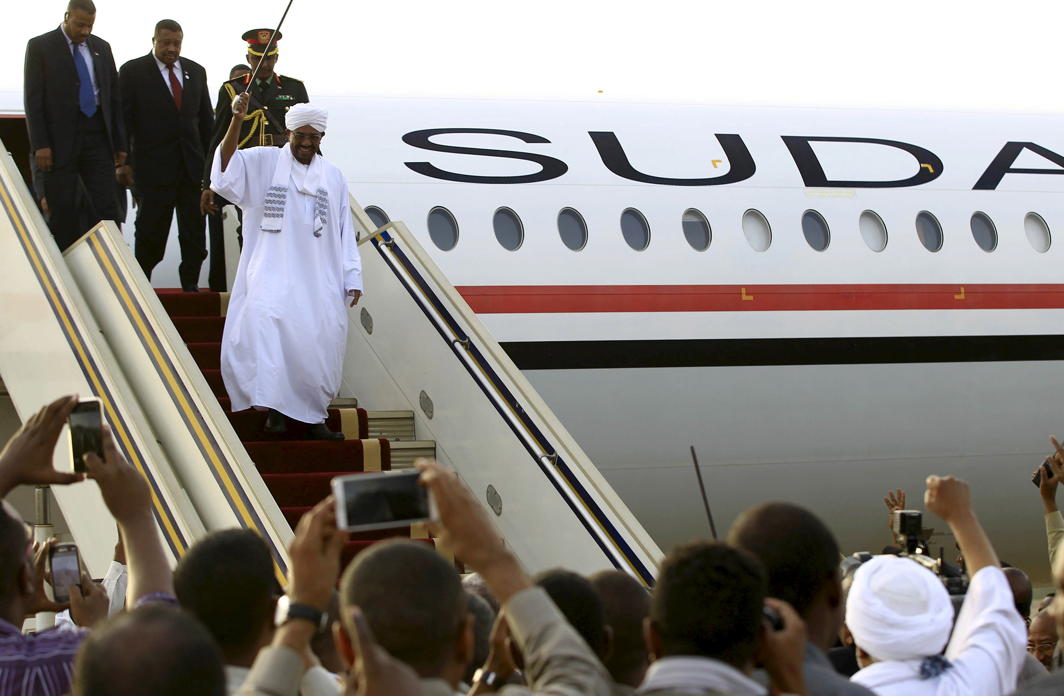 "Sudanese President Omar al-Bashir disembarks from the plane, after attending an African Union conference in Johannesburg South Africa, at the airport in the capital Khartoum, Sudan June 15, 2015. Al-Bashir flew out of South Africa on Monday in defiance of a Pretoria court that later said he should have been arrested to face genocide charges at the International Criminal Court. Despite a legal order for him to stay in the country ahead of the ruling on his detention, the government let Bashir leave unhindered, with South Africa's ruling party accusing the ICC of being biased against Africans and ""no longer useful"".   REUTERS/Mohamed Nureldin Abdallah      TPX IMAGES OF THE DAY      - RTX1GM4W"