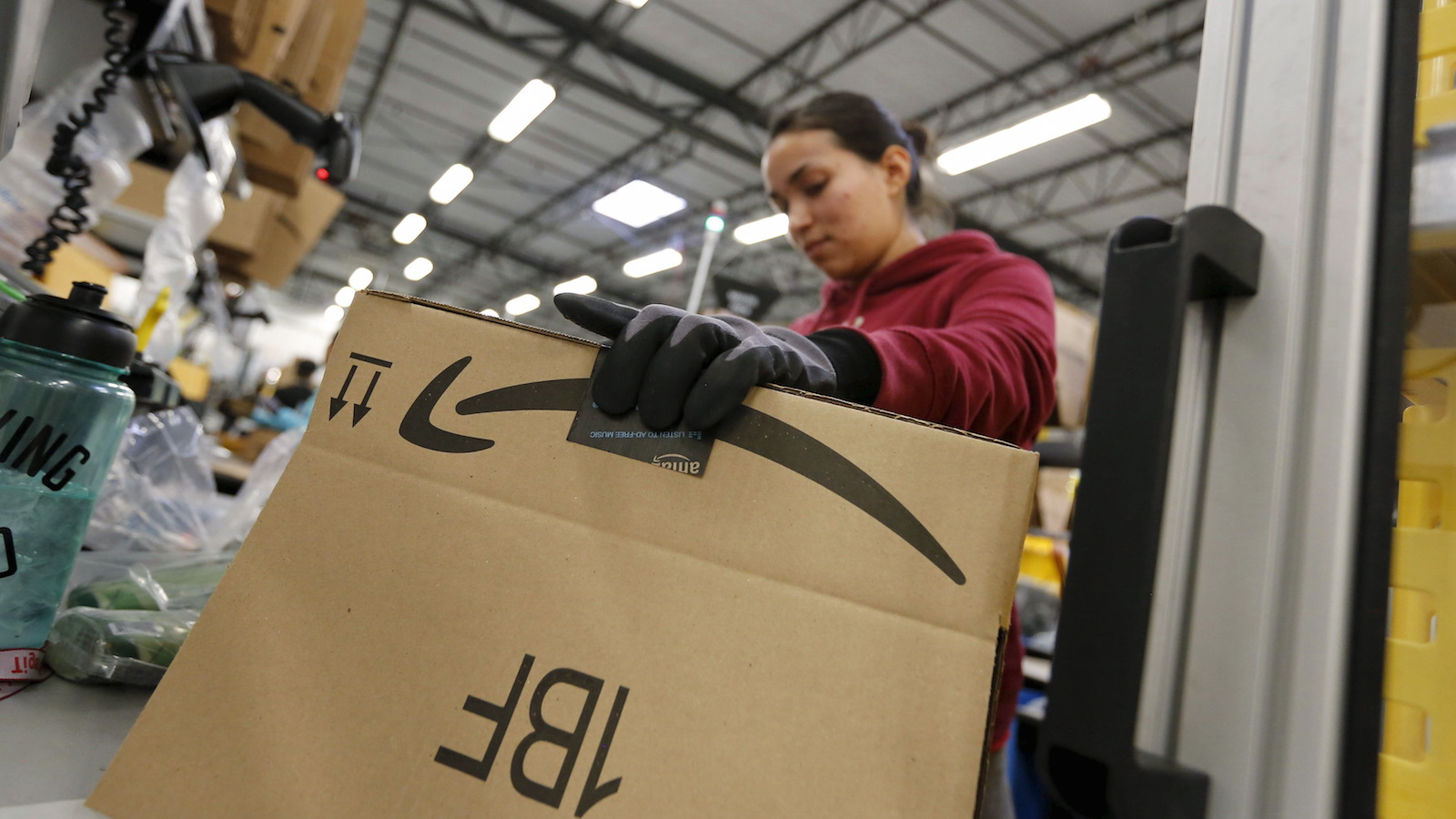 Maria Alcanta prepares a box for a customer's items at the Amazon Fulfillment Center in Tracy, California, November 29, 2015. U.S. holiday shopping is on track for a modest 3.7 percent rise this year after strong turnout during the Thanksgiving and Black Friday weekend and thanks to strong online sales, the National Retail Federation said on Sunday after releasing an annual consumer poll. REUTERS/Fred Greaves - RTX1WF36