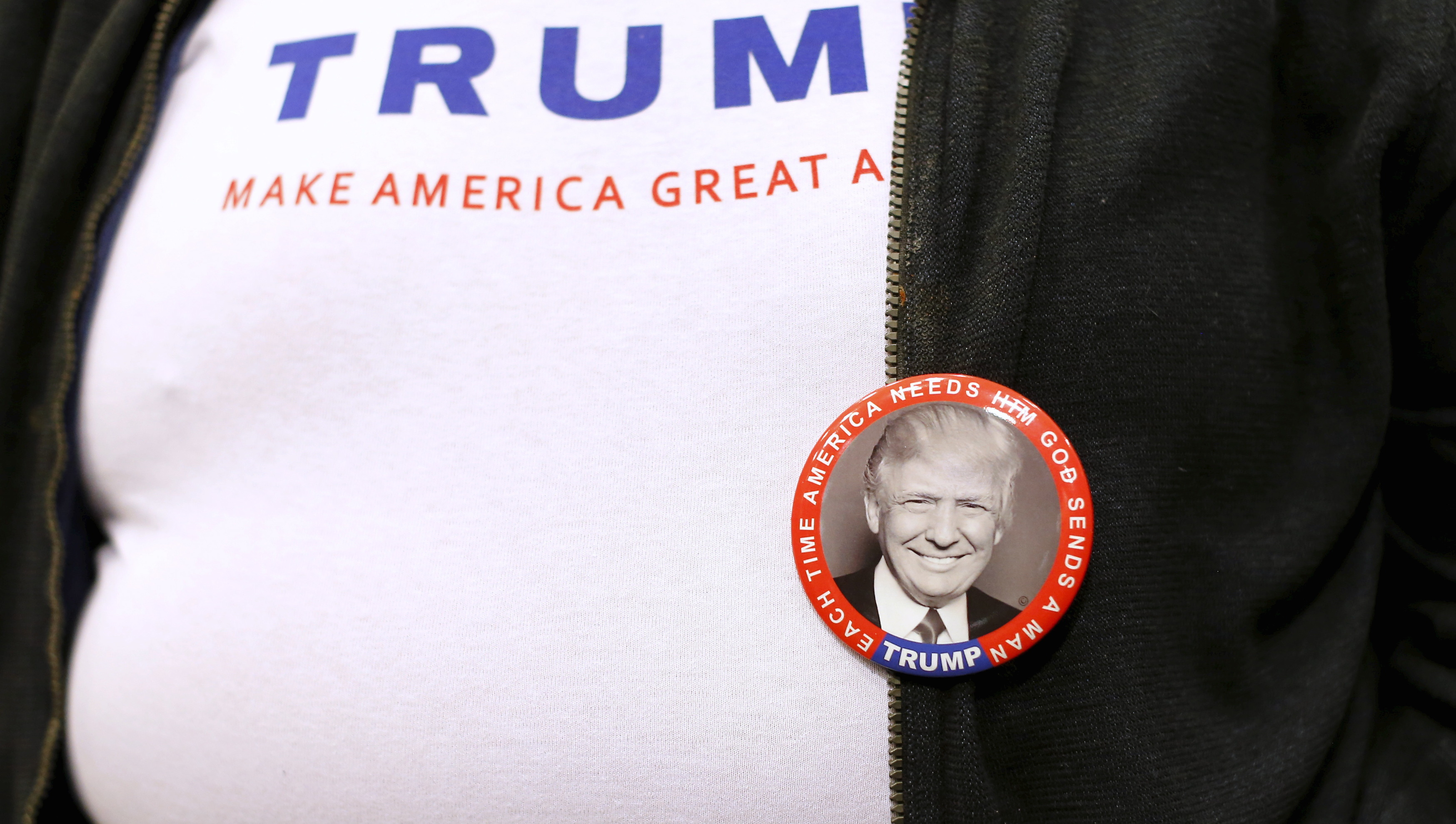 A supporter wears a t-shirt and button as he attends a rally for U.S. Republican presidential candidate Donald Trump in Las Vegas