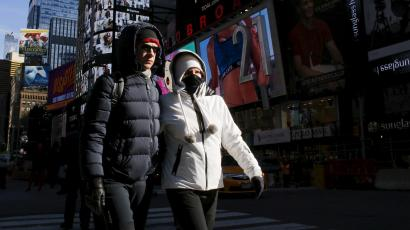 People are seen bundled up from the cold in Times Square, NewYork February 12, 2016.