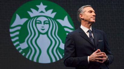 Starbucks Chief Executive Howard Schultz speaks during the company's annual shareholder's meeting in Seattle, Washington March 18, 2015. Starbucks Corp will begin offering delivery in New York City and Seattle later this year, when it also plans to expand mobile order and pay services across the United States.