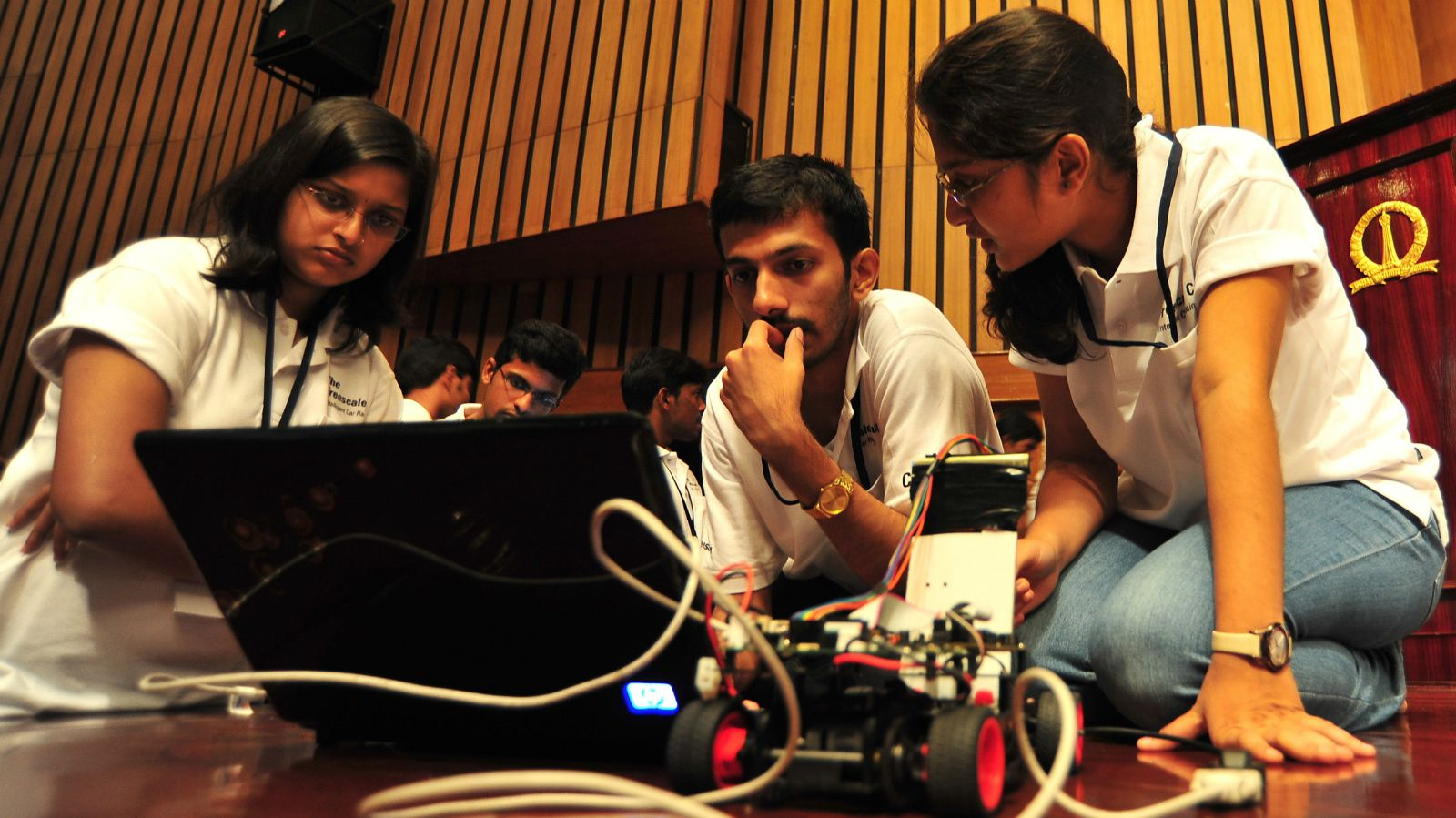epa02925247 Engineering students from various colleges prepare their smart cars before taking part in the 'unique intelligent car race' for engineering students organized by Freescale Semiconductor India in association with Centre for Electronic Design and Technology (CEDT) from the Indian Institute of Science, in the southern Indian city of Bangalore, on 19 September 2011. Around 127 teams from 35 engineering college students across India, take part in the Freescale's global imitative to promote innovation among engineering students and offer them a hands on opportunity to their engineering skills to test by creating microcontroller (MCU) programming that enables model cars to perform optimally under test conditions during the race. EPA/JAGADEESH NV